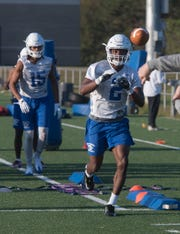 Rodney Coates runs through spring drills with the rest of the University of West Florida football team during practice on Thursday, March 21, 2019.
