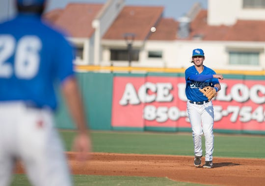 Shortstop Robert Lopez (9) throws to first while warming up in between innings during the University of Wisconsin-Whitewater vs University of West Florida baseball game at Blue Wahoos Stadium in Pensacola on Wednesday, March 20, 2019.