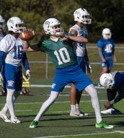 Colorado State transfer, JC Robles, runs through spring drills with the rest of the University of West Florida football team during practice on Thursday, March 21, 2019.