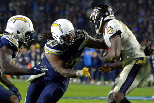 Chargers defensive tackle Darius Philon (93) sacks Ravens quarterback Lamar Jackson (8) during the fourth quarter of a game at StubHub Center.