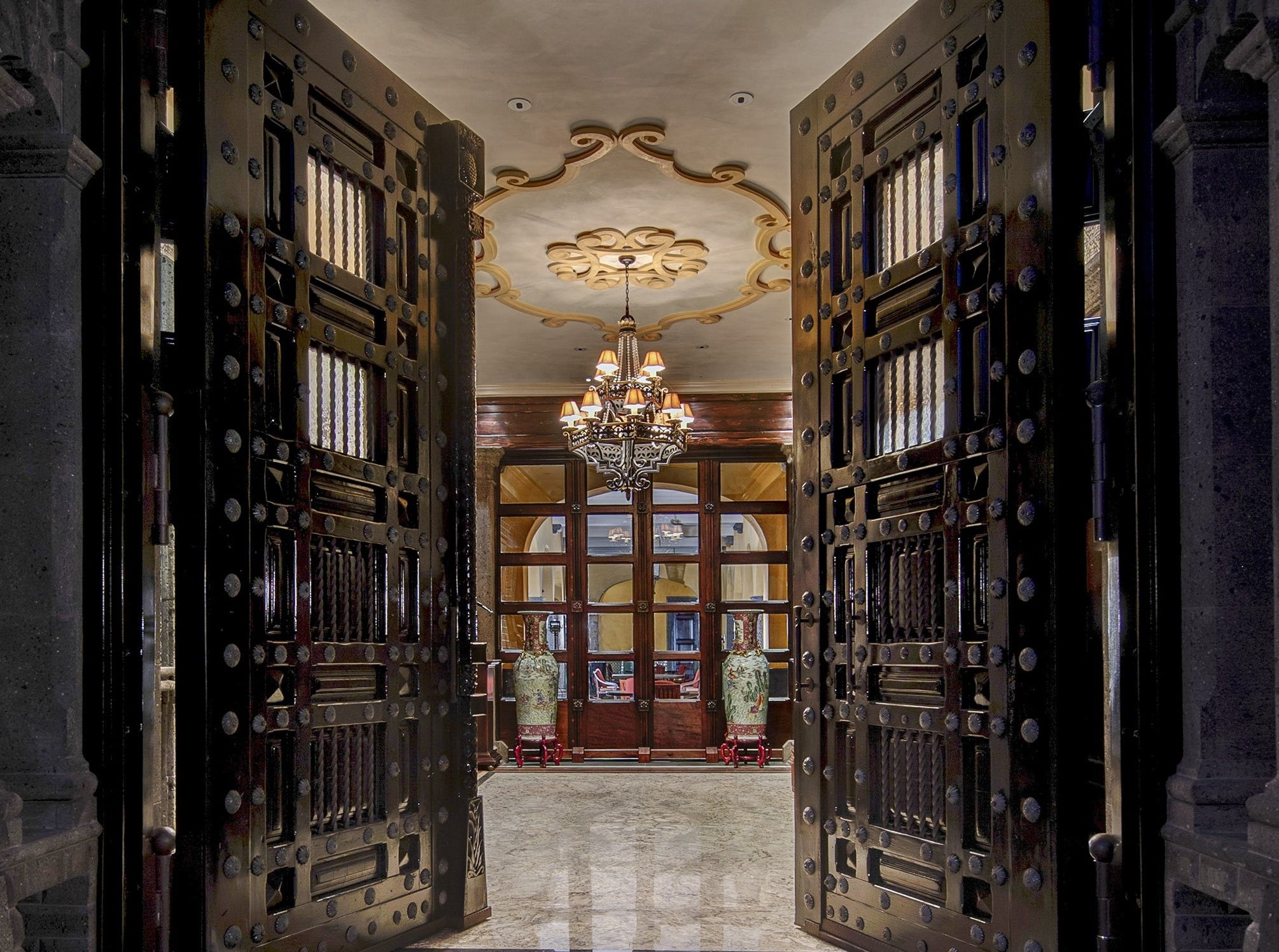The palatial Mediterranean-style Paradise Valley mansion purchased by Amy Connor features stunning Honduran Mahogany entry doors.