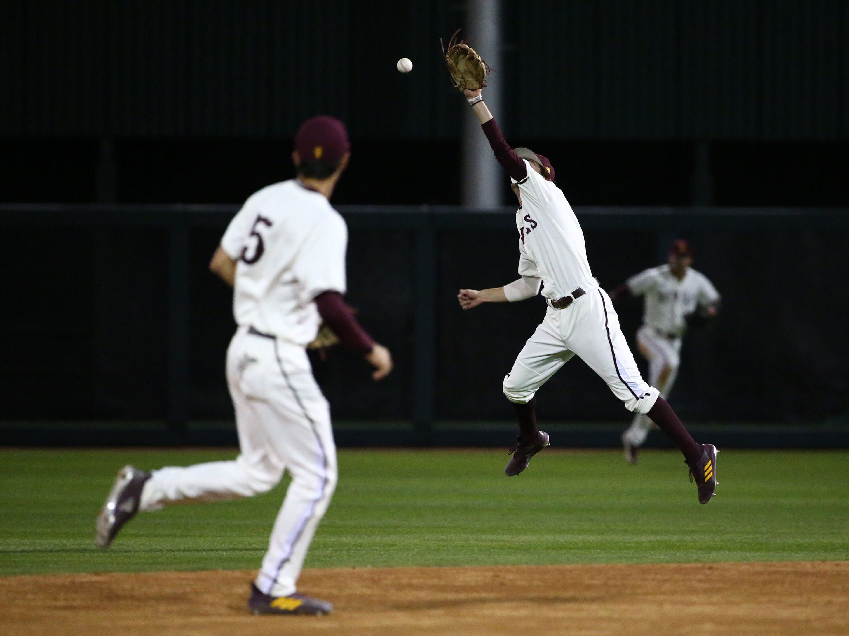 Arizona State Sun Devils second baseman Drew Swift jumps but can't make a play on a ground ball from California Baptist Lancers Chad Castillo in the second inning at Phoenix Municipal Stadium on Mar. 20, 2019 in Phoenix, Ariz.