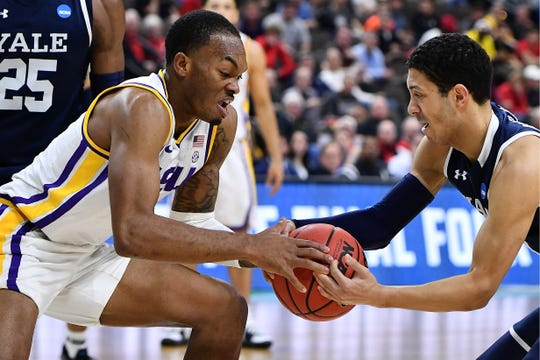 Mar 21, 2019; Jacksonville, FL, USA; LSU Tigers guard Javonte Smart (1) battles Yale Bulldogs guard Alex Copeland (right) for the ball during the second half in the first round of the 2019 NCAA Tournament at Jacksonville Veterans Memorial Arena. Mandatory Credit: John David Mercer-USA TODAY Sports
