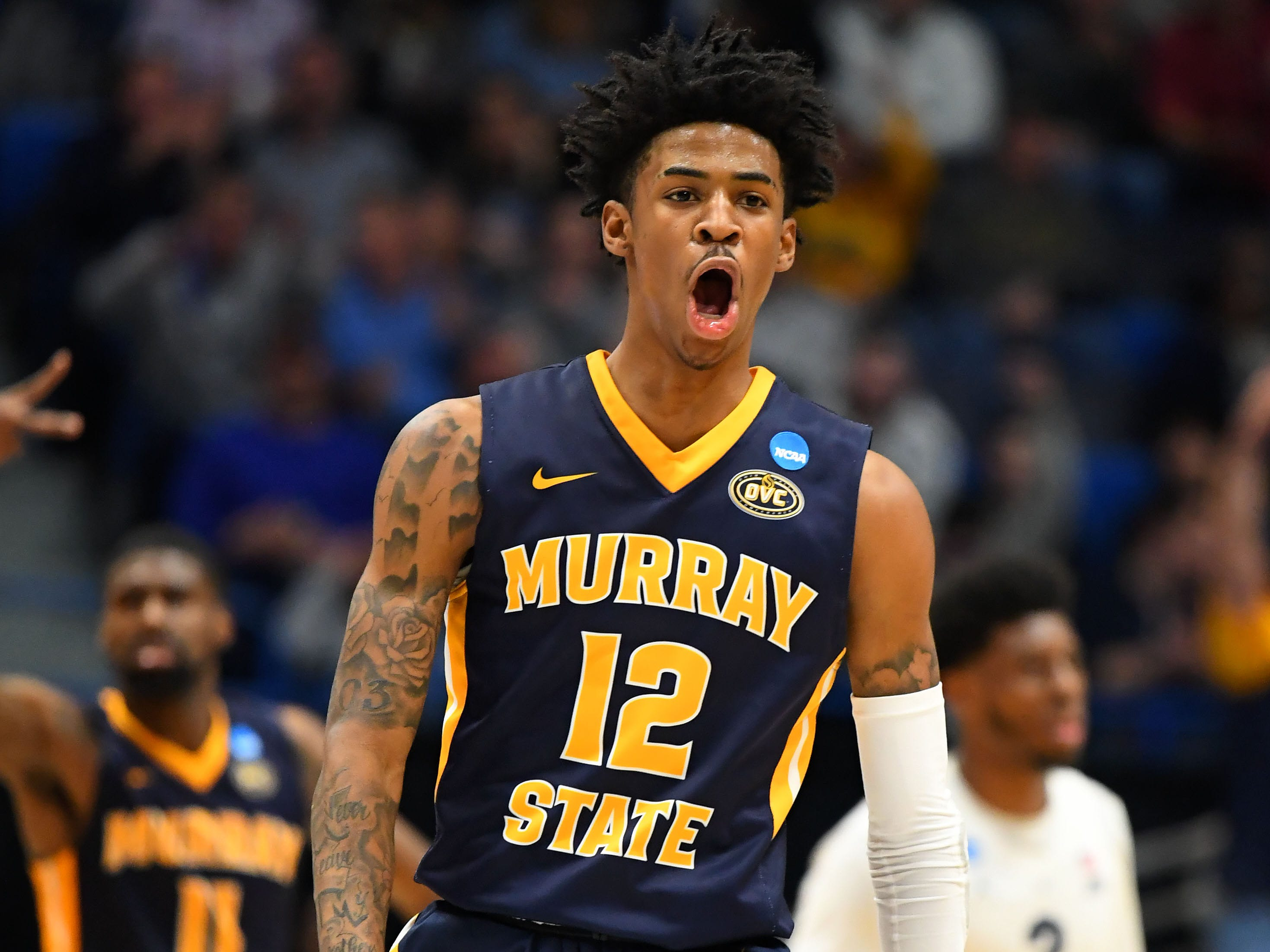 Mar 21, 2019; Hartford, CT, USA; Murray State Racers guard Ja Morant (12) reacts to a score against the Marquette Golden Eagles during the first half in the first round of the 2019 NCAA Tournament at XL Center. Mandatory Credit: Robert Deutsch-USA TODAY Sports