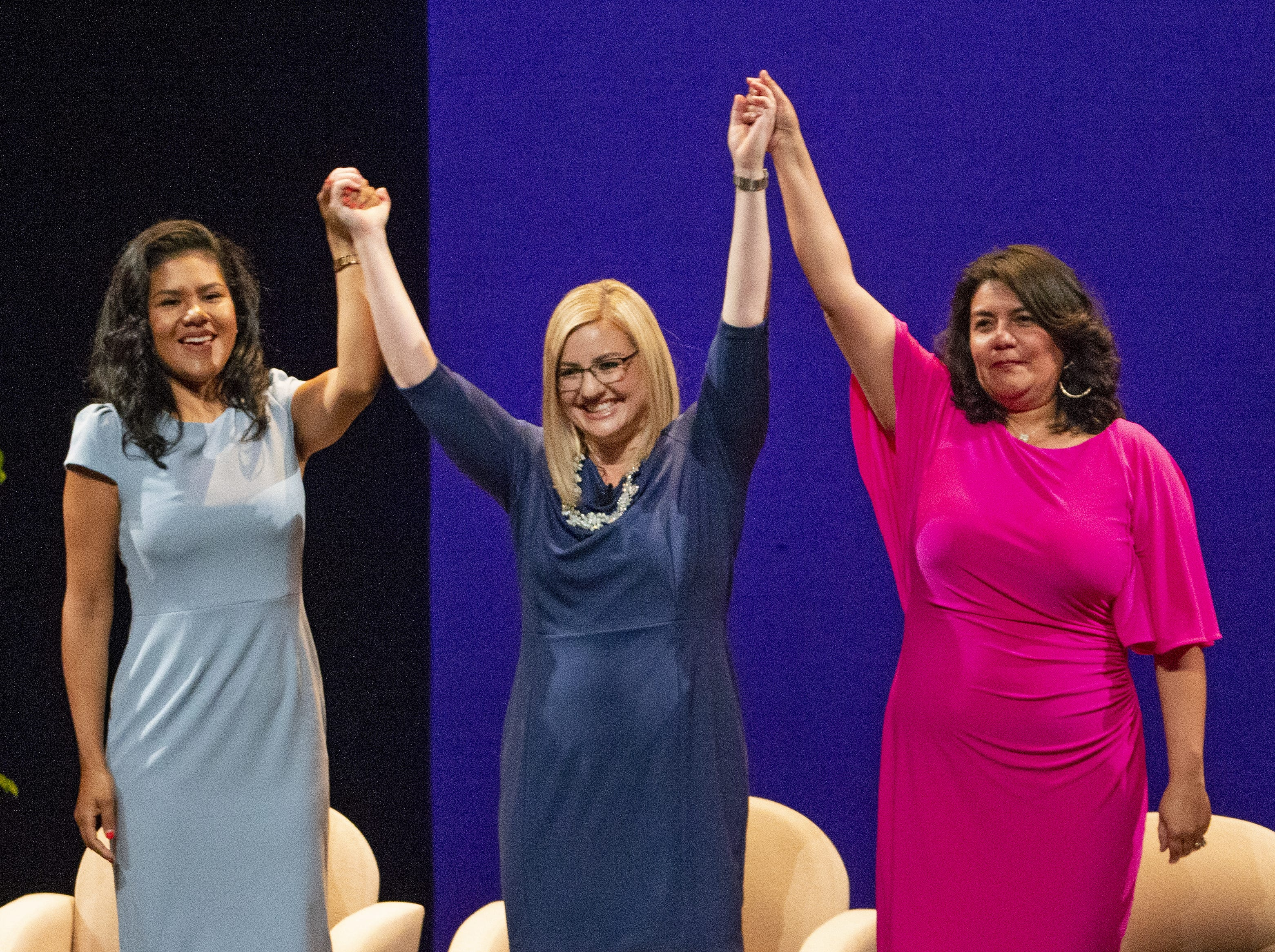 (from left to right) Councilwoman Varia Guevara, District 5; newly-inaugurated Phoenix Mayor Kate Gallego; and Councilwoman Laura Pastor, District 4 celebrate during Gallego's inauguration ceremony on March 21 at the Orpheum Theatre in Phoenix, Ariz.