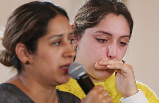 Paulina Ramirez (right) sister-in-law of the arrested man, Jesus Antonio Torres, cries while Dennice Sanchez, a friend of Glenda de la Vega Fernandez, speaks during a press conference on March 20, 2019, at Southside Presbyterian Church, 317 W. 23rd St., in Tucson. A family of three was arrested after a traffic stop by a state trooper where Border Patrol was called to assist.