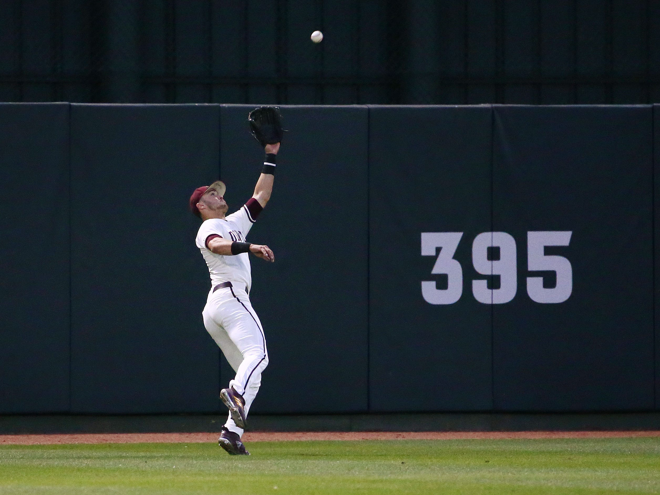 Arizona State Sun Devils center fielder Hunter Bishop makes a catch on a fly ball from California Baptist Lancers John Glenn in the second inning at Phoenix Municipal Stadium on Mar. 20, 2019 in Phoenix, Ariz.
