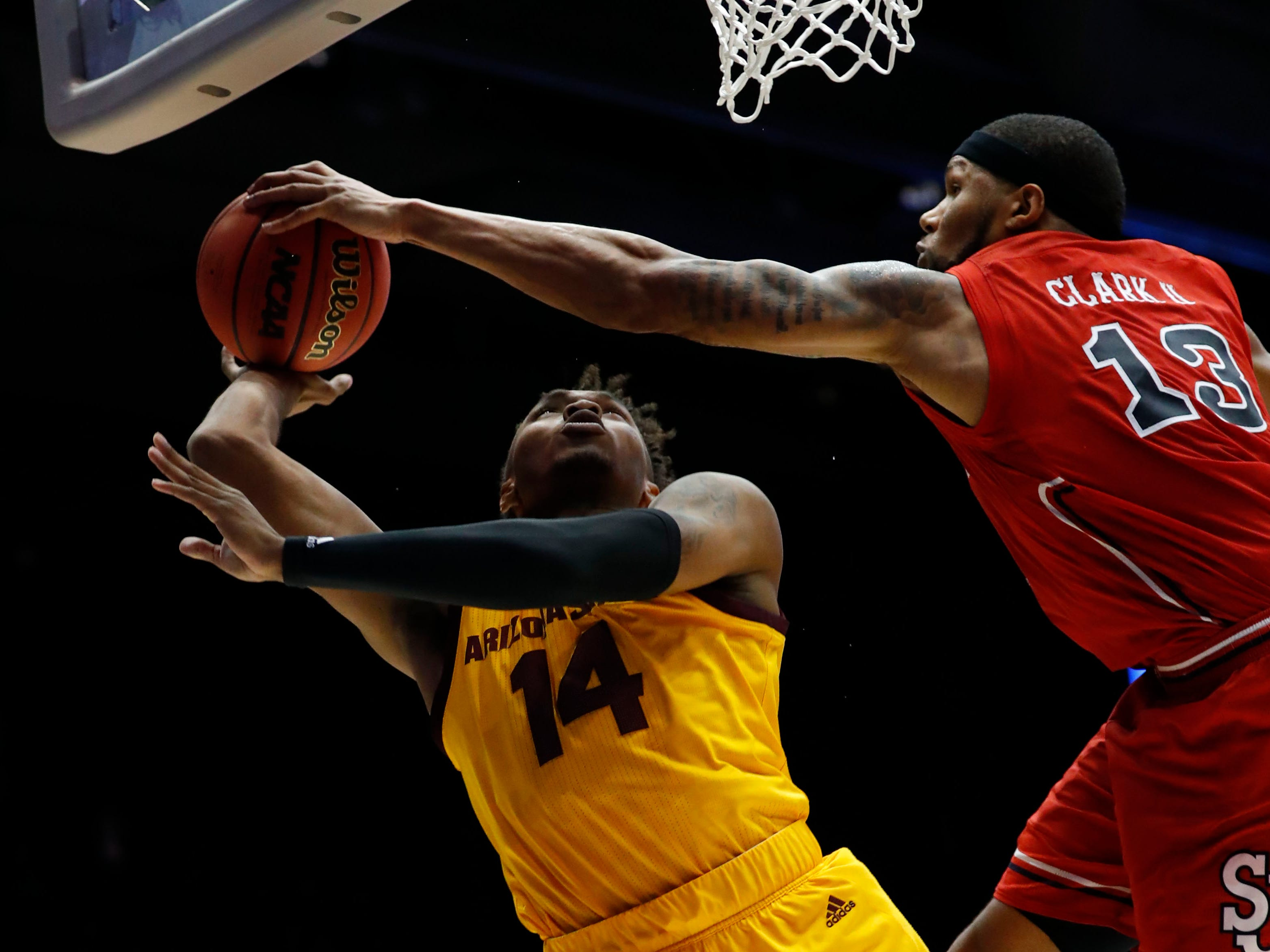 Mar 20, 2019; Dayton, OH, USA; St. John's Red Storm forward Marvin Clark II (13) blocks a shot from Arizona State Sun Devils forward Kimani Lawrence (14) in the second half in the First Four of the 2019 NCAA Tournament at Dayton Arena. Mandatory Credit: Rick Osentoski-USA TODAY Sports