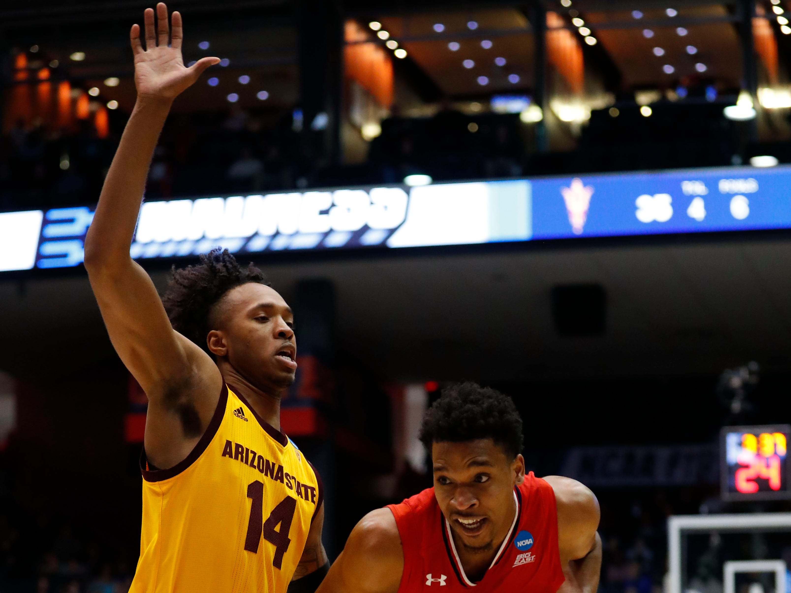 Mar 20, 2019; Dayton, OH, USA; St. John's Red Storm guard Justin Simon (5) moves down the court defended by Arizona State Sun Devils forward Kimani Lawrence (14) in the first half in the First Four of the 2019 NCAA Tournament at Dayton Arena. Mandatory Credit: Rick Osentoski-USA TODAY Sports
