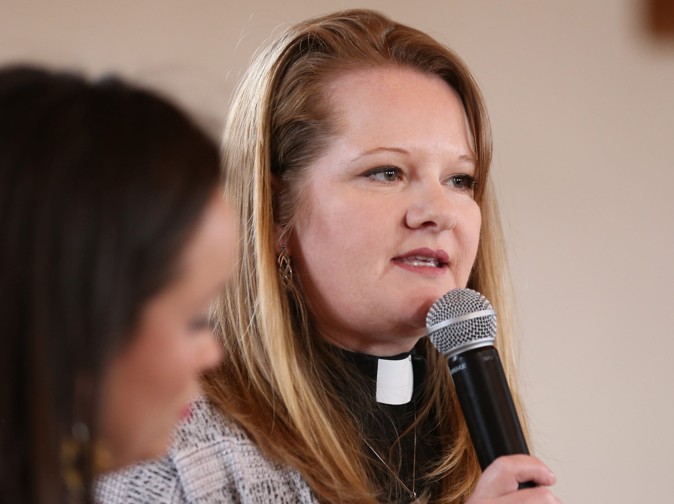 Alison Harrington, pastor, speaks during a press conference on March 20, 2019, at Southside Presbyterian Church, 317 W. 23rd St., in Tucson. A family of three was arrested after a traffic stop by a state trooper where Border Patrol was called to assist.
