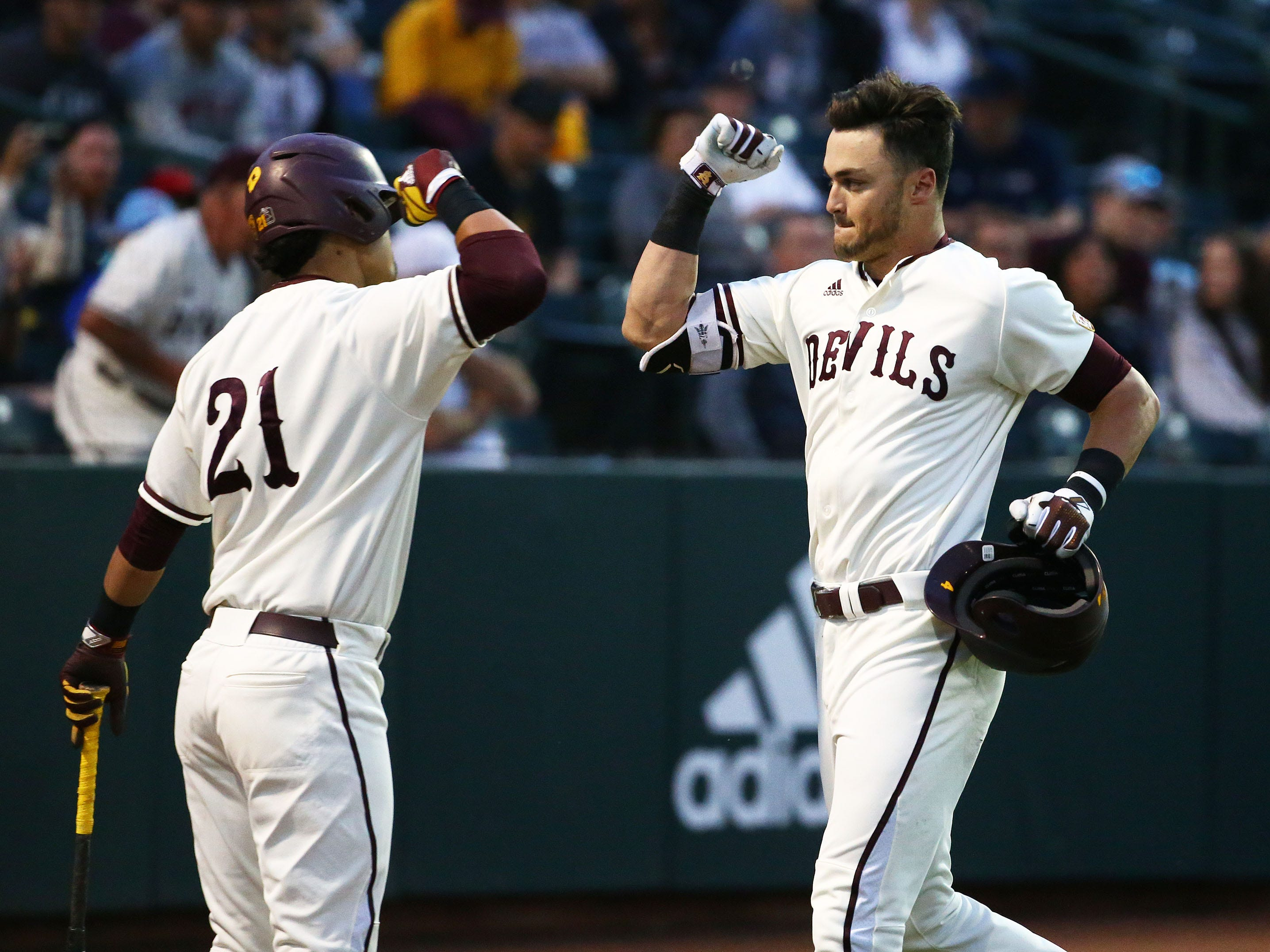 Arizona State Sun Devils Hunter Bishop (right) fist-pumps with Carter Aldrete (21) after hitting a solo home run against the California Baptist Lancers in the first inning at Phoenix Municipal Stadium on Mar. 20, 2019 in Phoenix, Ariz.