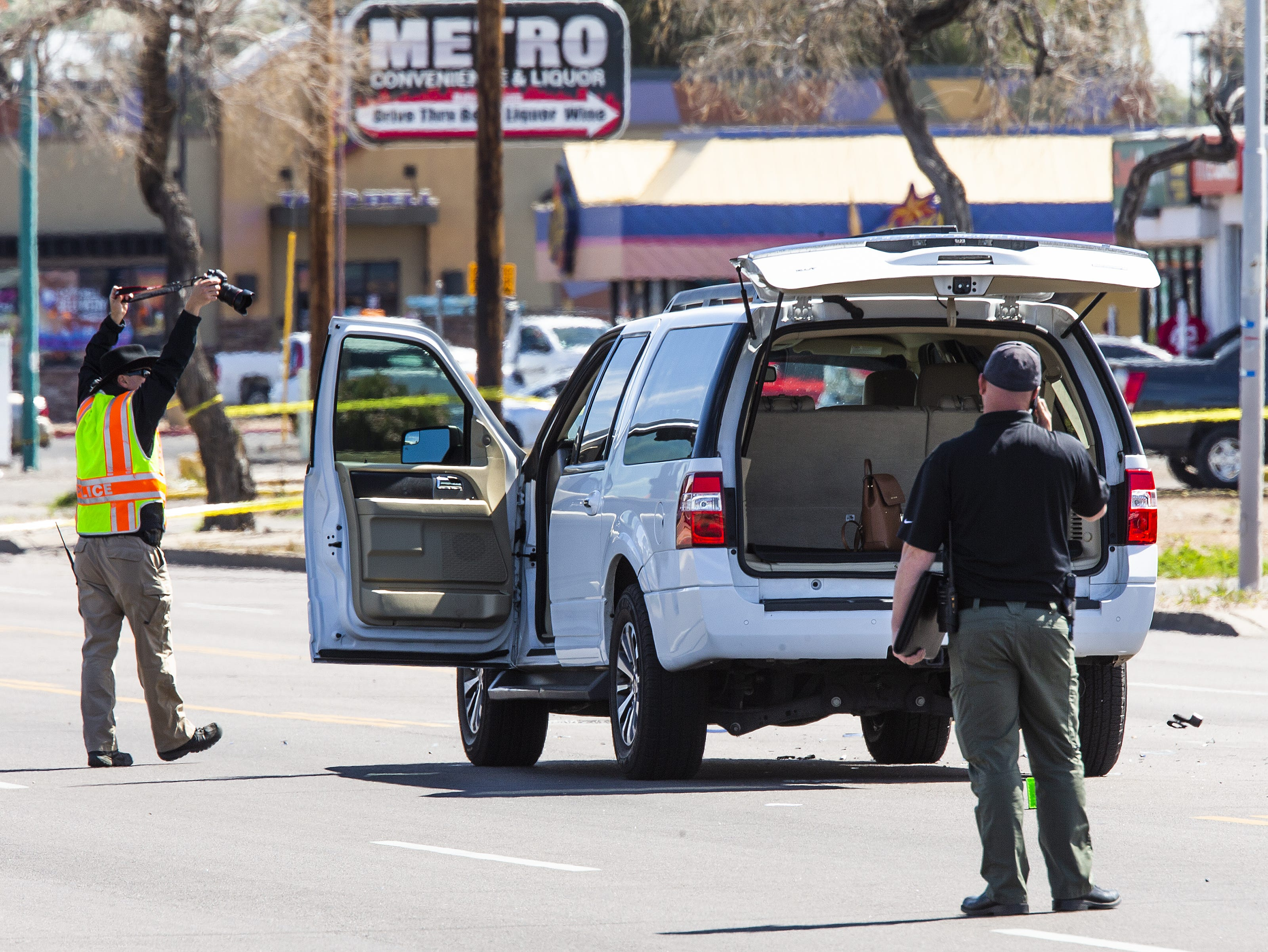 The scene at Indian School Road near 75th Avenue in Phoenix on March 21, 2019, where a Phoenix police officer was struck while investigating a crash. He later died from the injuries.