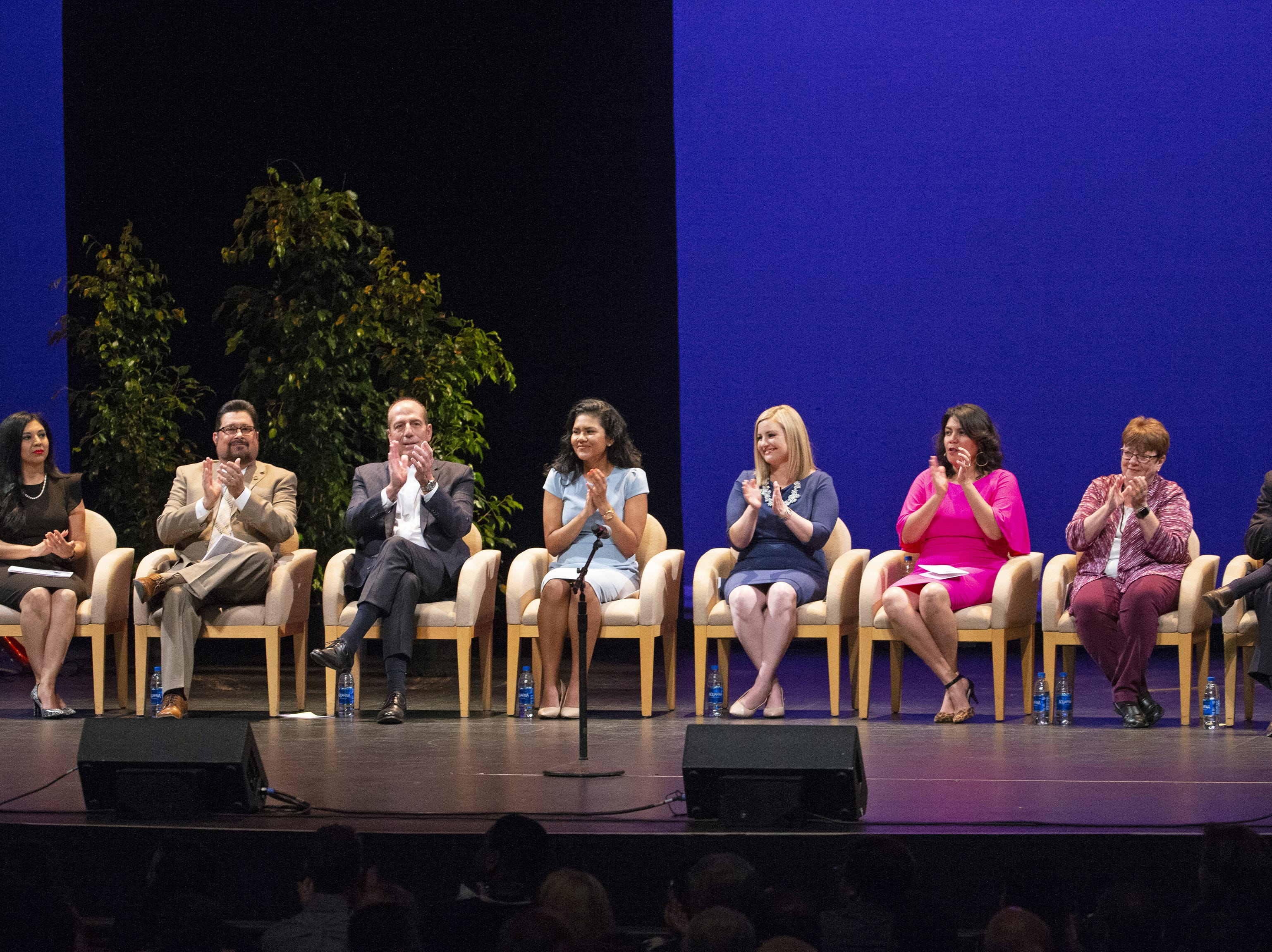 Kate Gallego (center right) and city council members sit onstage during Gallego's  inauguration ceremony as the new mayor of Phoenix on March 21 at the Orpheum Theatre in Phoenix, Ariz.