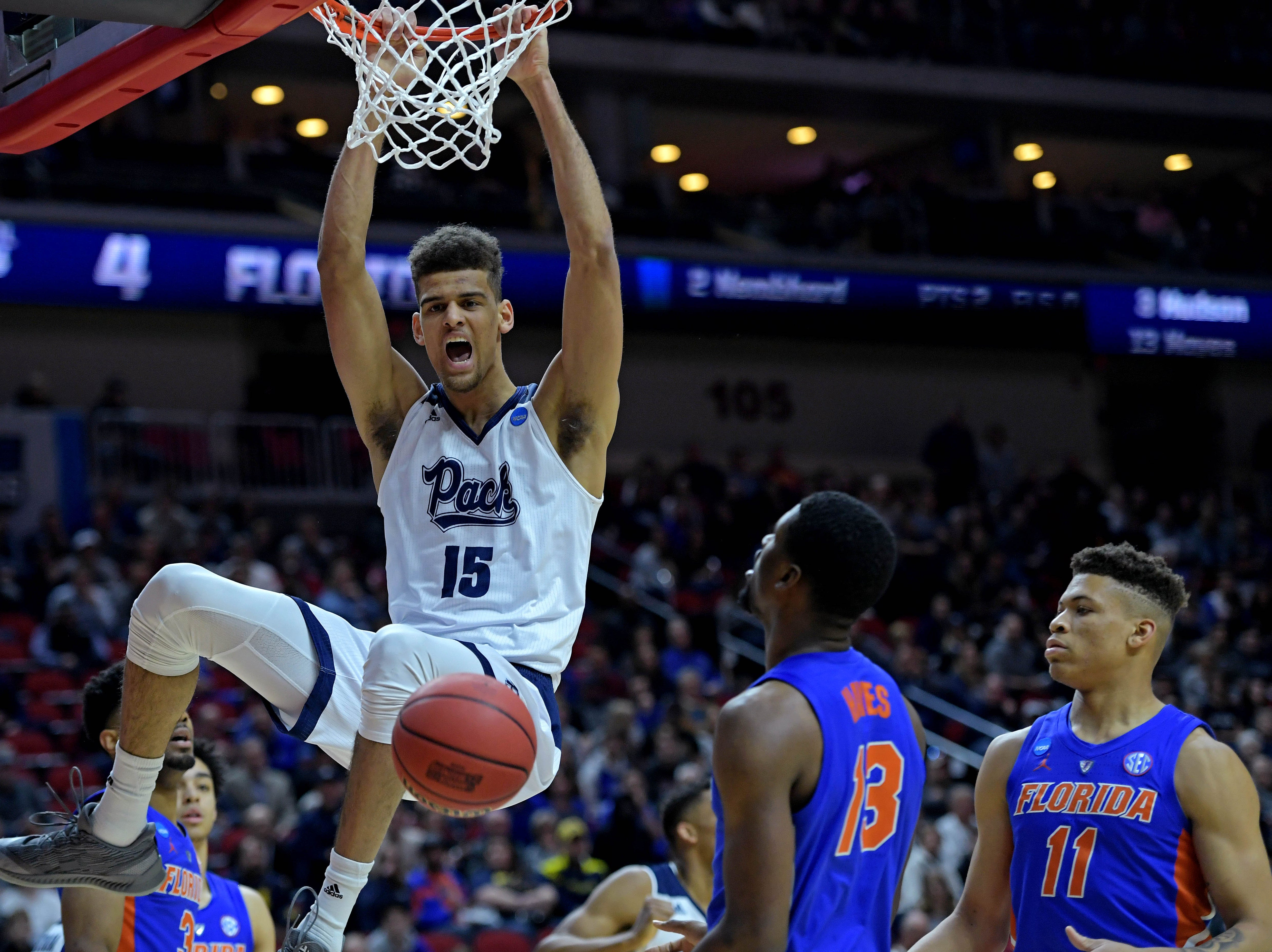 Mar 21, 2019; Des Moines, IA, United States; Nevada Wolf Pack forward Trey Porter (15) dunks the ball against Florida Gators forward Keyontae Johnson (11) during the second half in the first round of the 2019 NCAA Tournament at Wells Fargo Arena. Mandatory Credit: Steven Branscombe-USA TODAY Sports