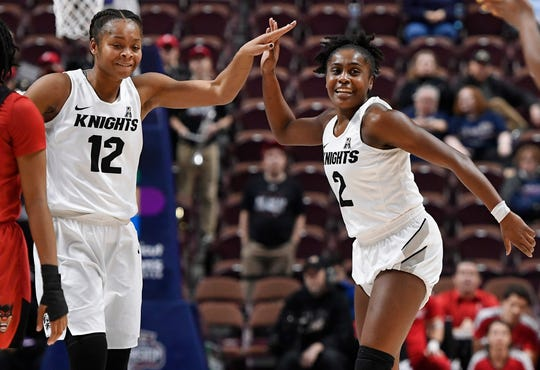 Central Florida's Nyala Shuler (12) and Central Florida's Kay Kay Wright (2) during the second half of an NCAA college basketball game in the American Athletic Conference women's tournament semifinals, Sunday, March 10, 2019, at Mohegan Sun Arena in Uncasville, Conn. (AP Photo/Jessica Hill)