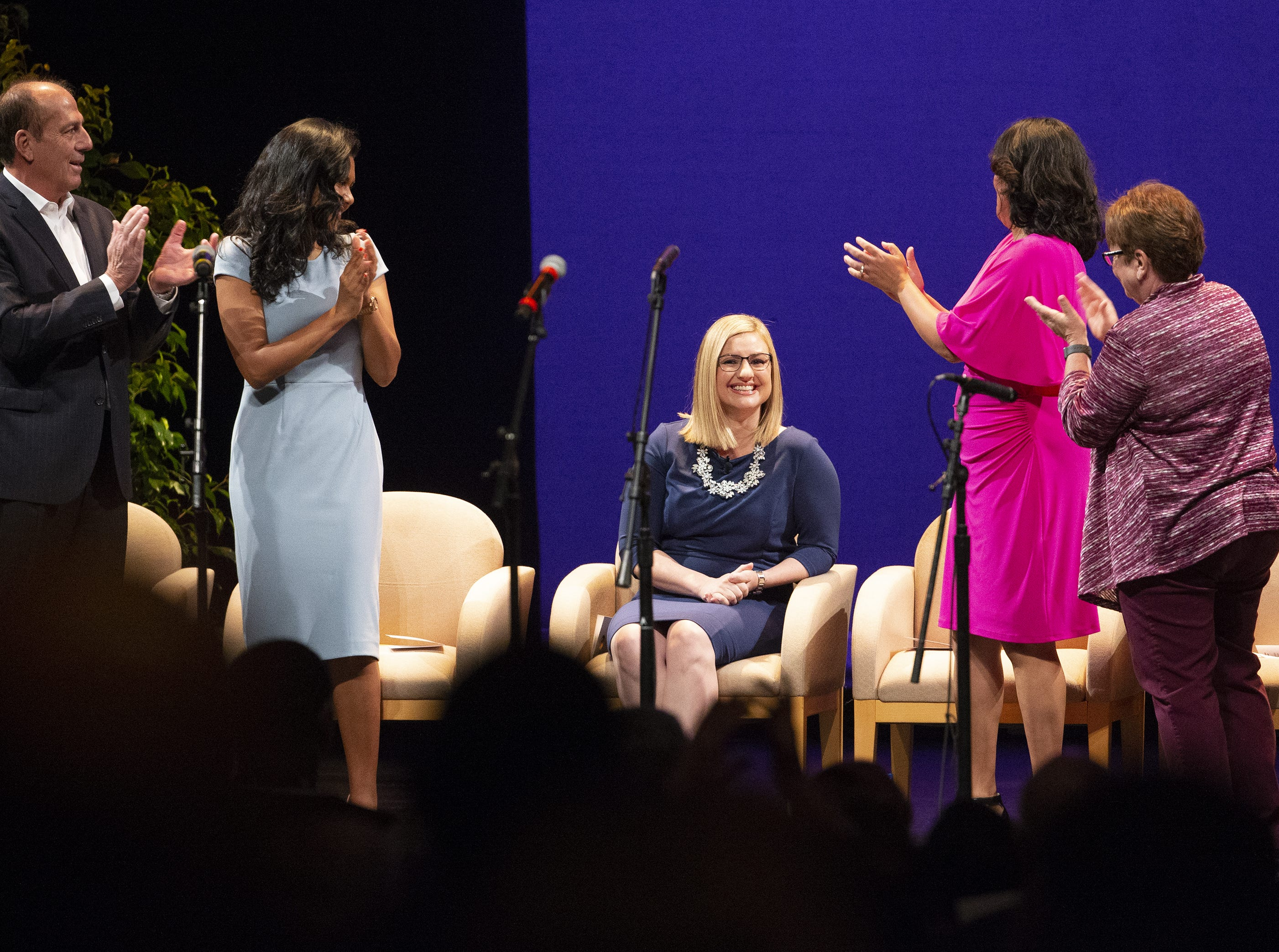 Kate Gallego is applauded as she takes the stage for her inauguration ceremony as the new mayor of Phoenix on March 21 at the Orpheum Theatre in Phoenix, Ariz.