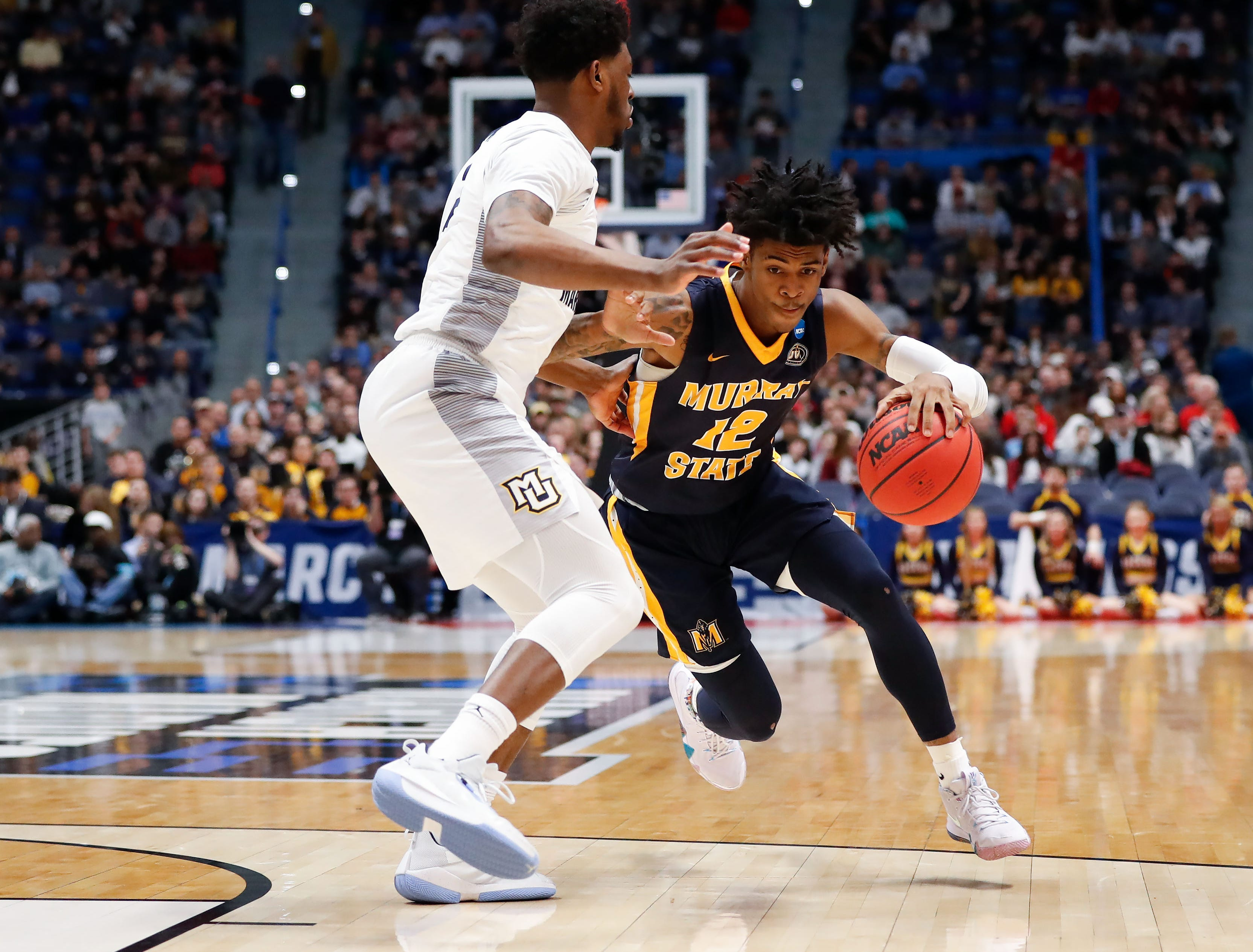 Mar 21, 2019; Hartford, CT, USA; Murray State Racers guard Ja Morant (12) drives against Marquette Golden Eagles forward Sacar Anim (2) during the first half of a game in the first round of the 2019 NCAA Tournament at XL Center. Mandatory Credit: David Butler II-USA TODAY Sports