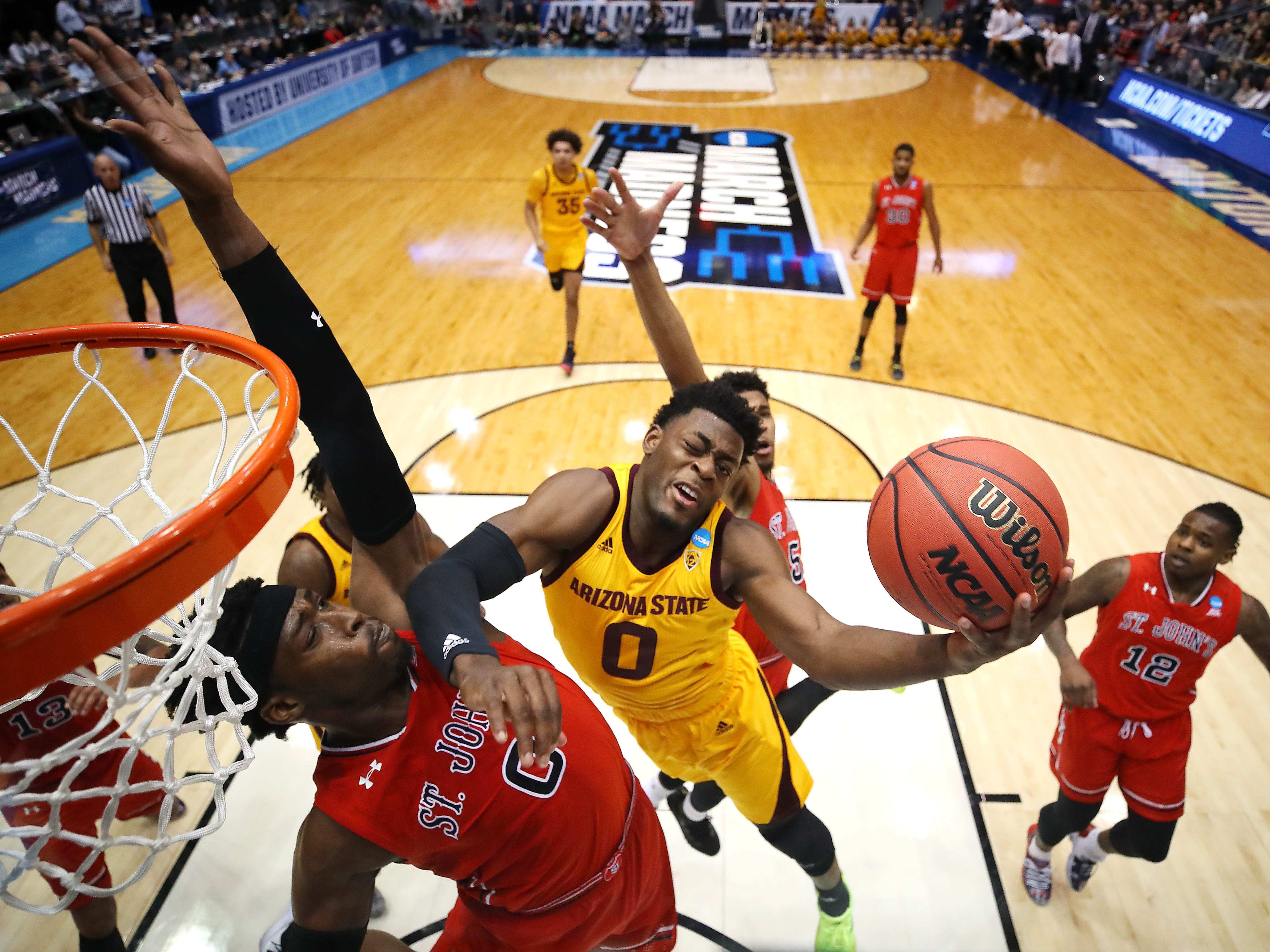 Luguentz Dort #0 of the Arizona State Sun Devils drives to the basket against Sedee Keita #0 of the St. John's Red Storm during the first half in the First Four of the 2019 NCAA Men's Basketball Tournament at UD Arena on March 20, 2019 in Dayton, Ohio.