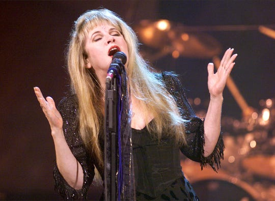 Stevie Nicks of Fleetwood Mac fame belts out a song during her concert at America West Arena on July 23, 1998. The concert benefited the Arizona Heart Institute.