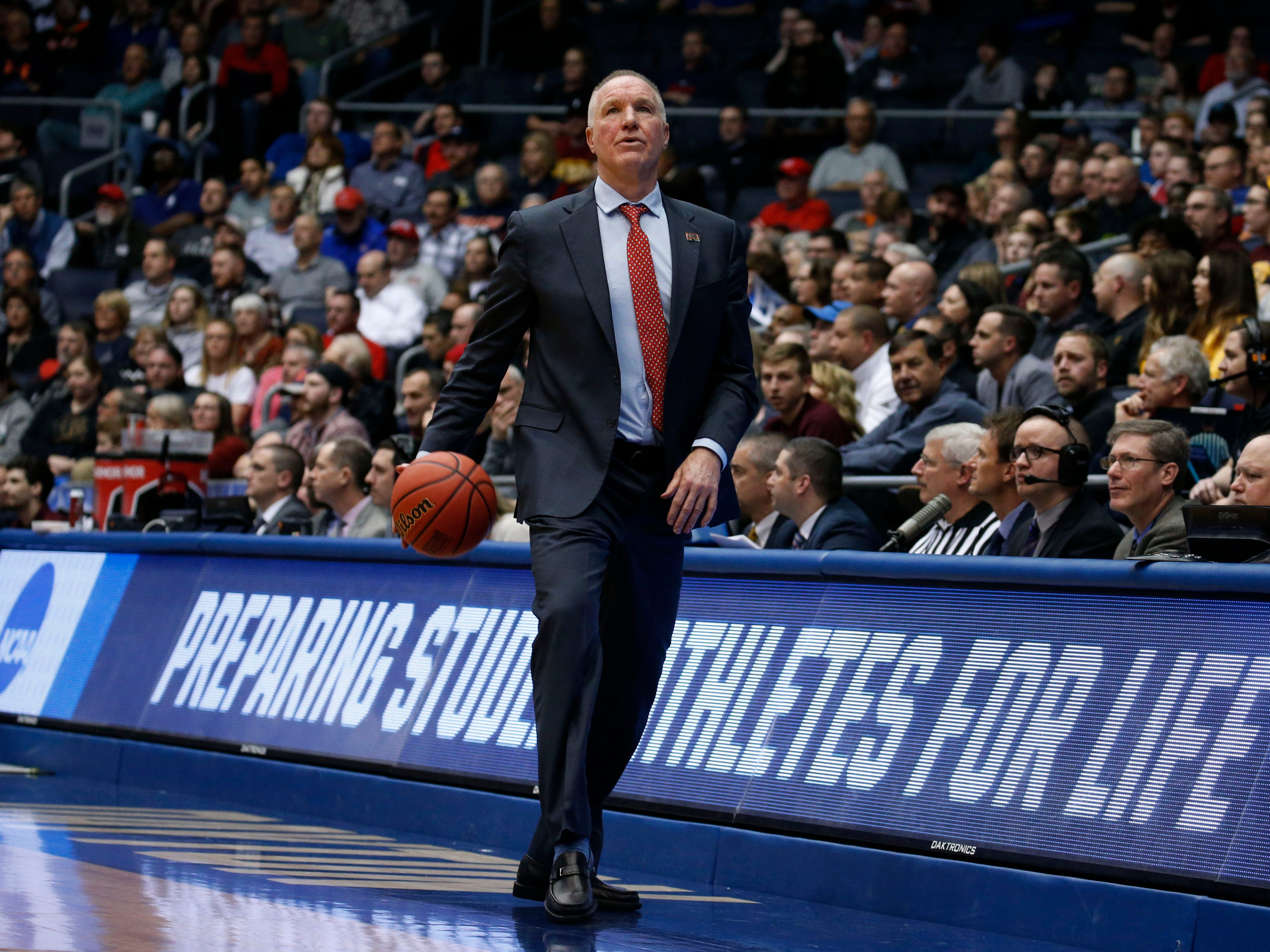 Mar 20, 2019; Dayton, OH, USA; St. John's Red Storm head coach Chris Mullin dribbles the ball down the court in the second half against the Arizona State Sun Devils in the First Four of the 2019 NCAA Tournament at Dayton Arena. Mandatory Credit: Brian Spurlock-USA TODAY Sports
