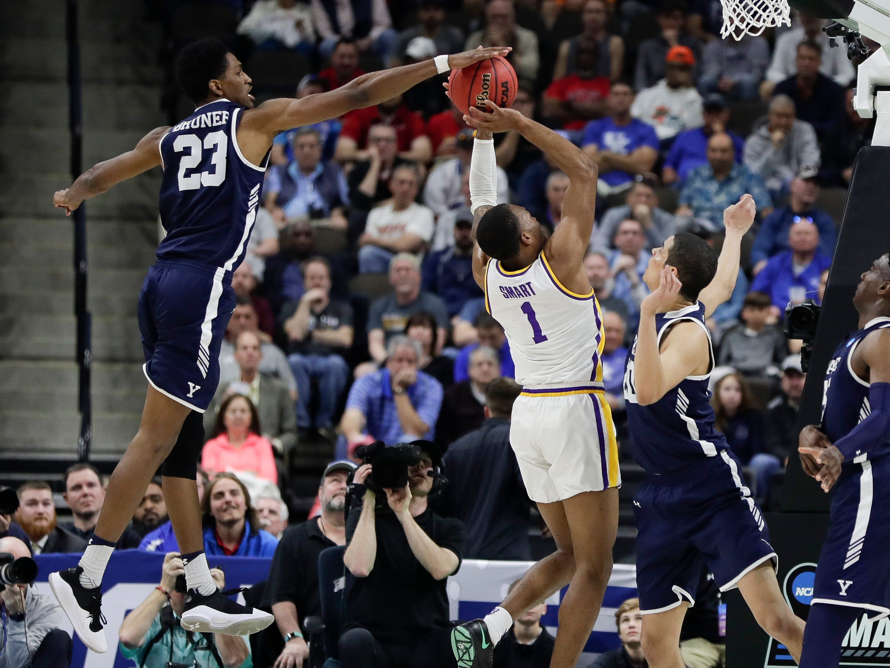 Yale forward Jordan Bruner (23) blocks a shot attempt by LSU's Javonte Smart (1) during the second half of a first round men's college basketball game in the NCAA Tournament, in Jacksonville, Fla. Thursday, March 21, 2019. (AP Photo/John Raoux)