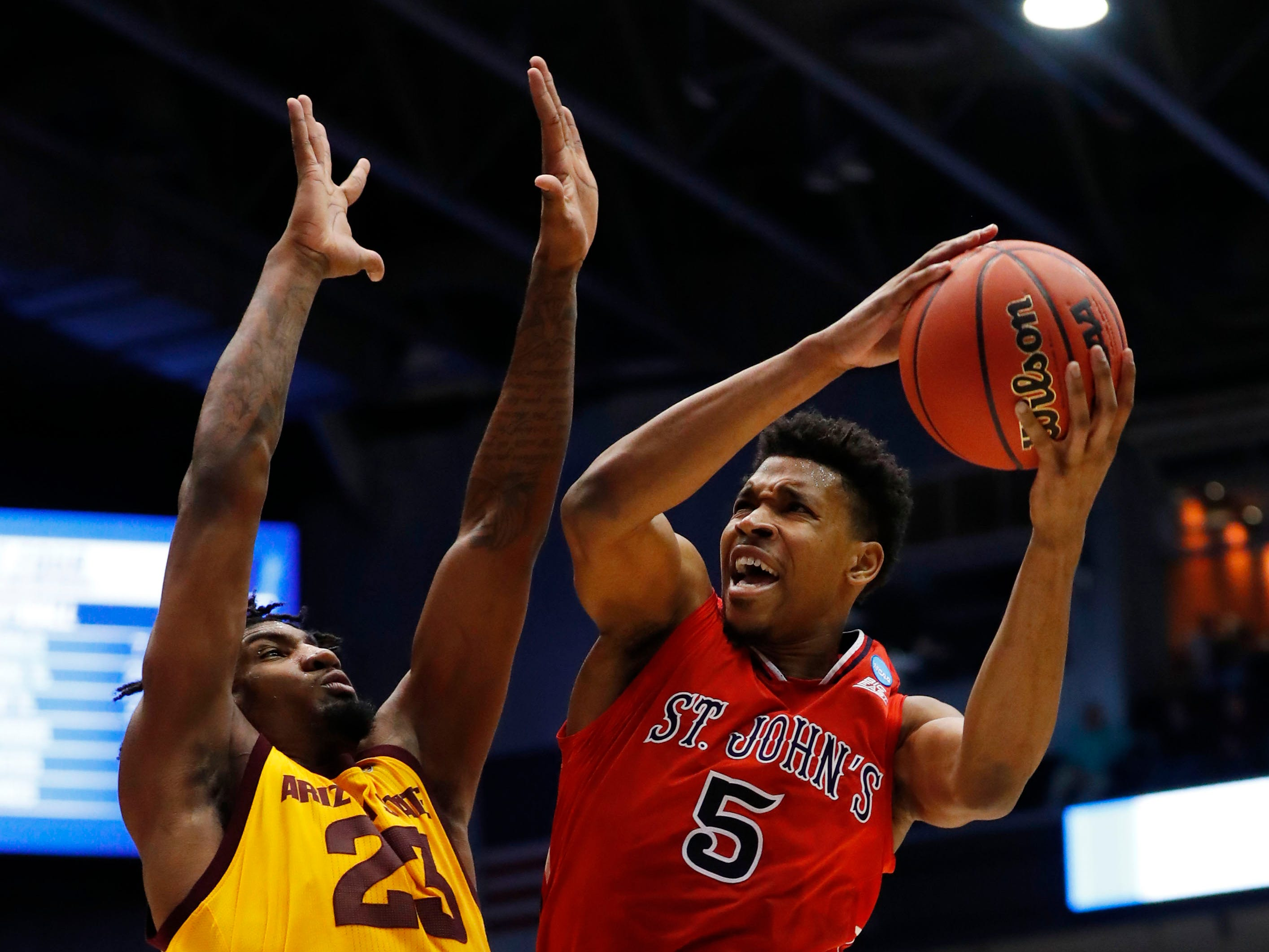 Mar 20, 2019; Dayton, OH, USA; St. John's Red Storm guard Justin Simon (5) goes to the basket defended by Arizona State Sun Devils forward Romello White (23) in the first half in the First Four of the 2019 NCAA Tournament at Dayton Arena. Mandatory Credit: Rick Osentoski-USA TODAY Sports