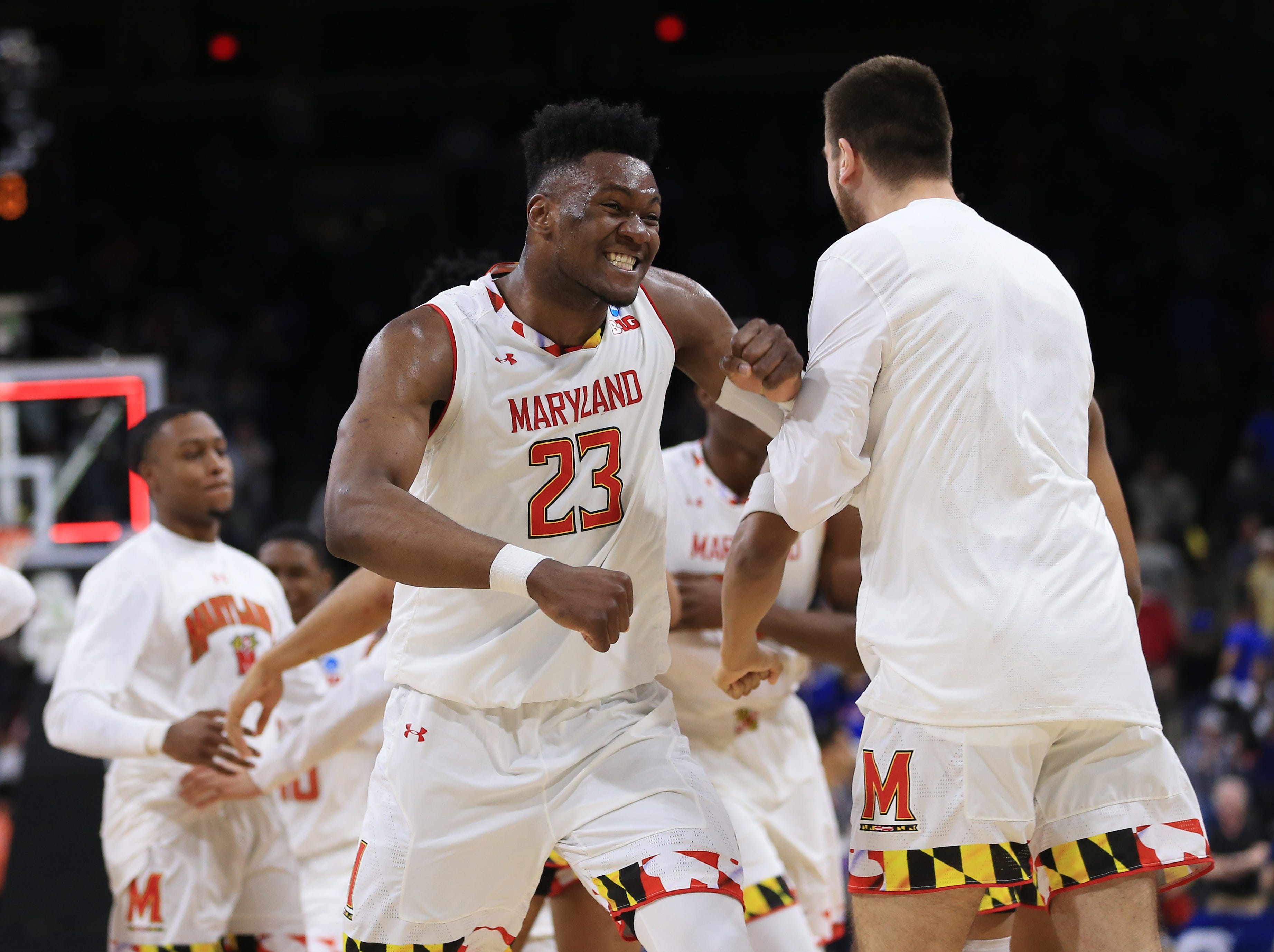 Mar 21, 2019; Jacksonville, FL, USA; Maryland Terrapins forward Bruno Fernando (23) celebrates with teammates after defeating the against the Belmont Bruins during the second half in the first round of the 2019 NCAA Tournament at Jacksonville Veterans Memorial Arena. Mandatory Credit: Matt Stamey-USA TODAY Sports