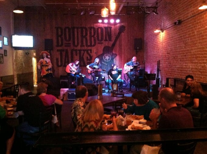 Bourbon Jacks Bar & Grill: In the space of a former 1918 Arrow Pharmacy building, this contemporary take on a country bar in downtown Chandler has more than 200 whiskies available. With country actsand cover bands playinglive music every night, it's a lively spot to have a drink and grab a bite to eat.Happy hour is 2-7 p.m. weekdays andreverse happy hour is 9 p.m.-midnightSundays through Wednesdays.The menu includesfilling dishes such as chicken fried steak, a green chile burger, Cowboy Chop salad and rib eye dip sandwich.Details:11 W. Boston St., Chandler, 480-664-1738,bourbonjacksaz.com.