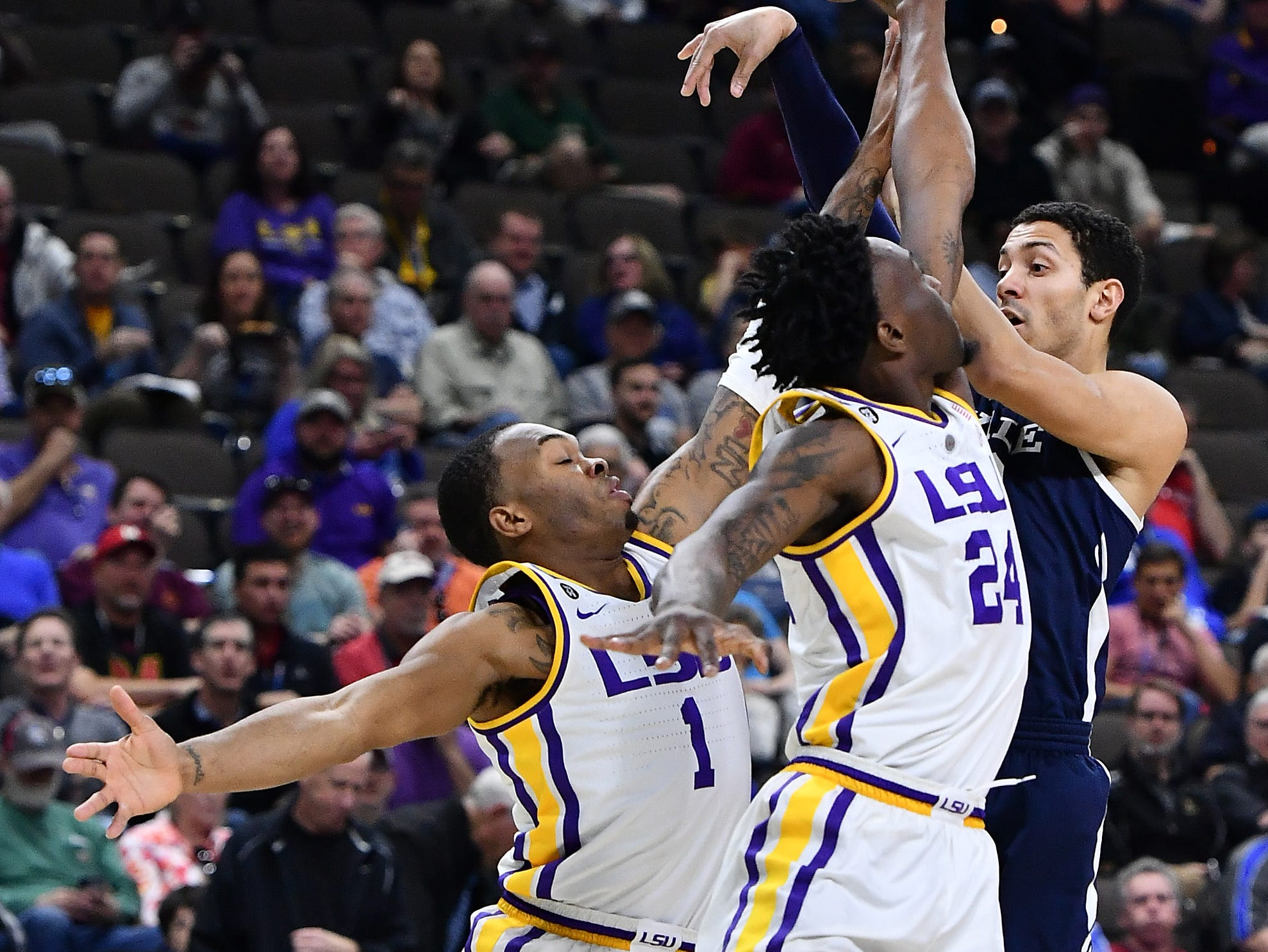 Mar 21, 2019; Jacksonville, FL, USA; Yale Bulldogs guard Alex Copeland (3) shoots against LSU Tigers guard Javonte Smart (1) and forward Emmitt Williams (24) during the first half in the first round of the 2019 NCAA Tournament at Jacksonville Veterans Memorial Arena. Mandatory Credit: John David Mercer-USA TODAY Sports