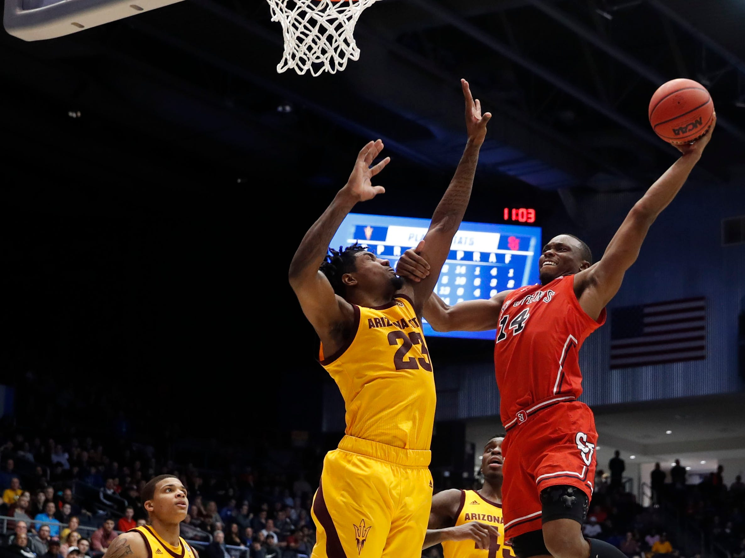 Mar 20, 2019; Dayton, OH, USA; St. John's Red Storm guard Mustapha Heron (14) goes to the basket defended by Arizona State Sun Devils forward Romello White (23) in the second half in the First Four of the 2019 NCAA Tournament at Dayton Arena. Mandatory Credit: Brian Spurlock -USA TODAY Sports