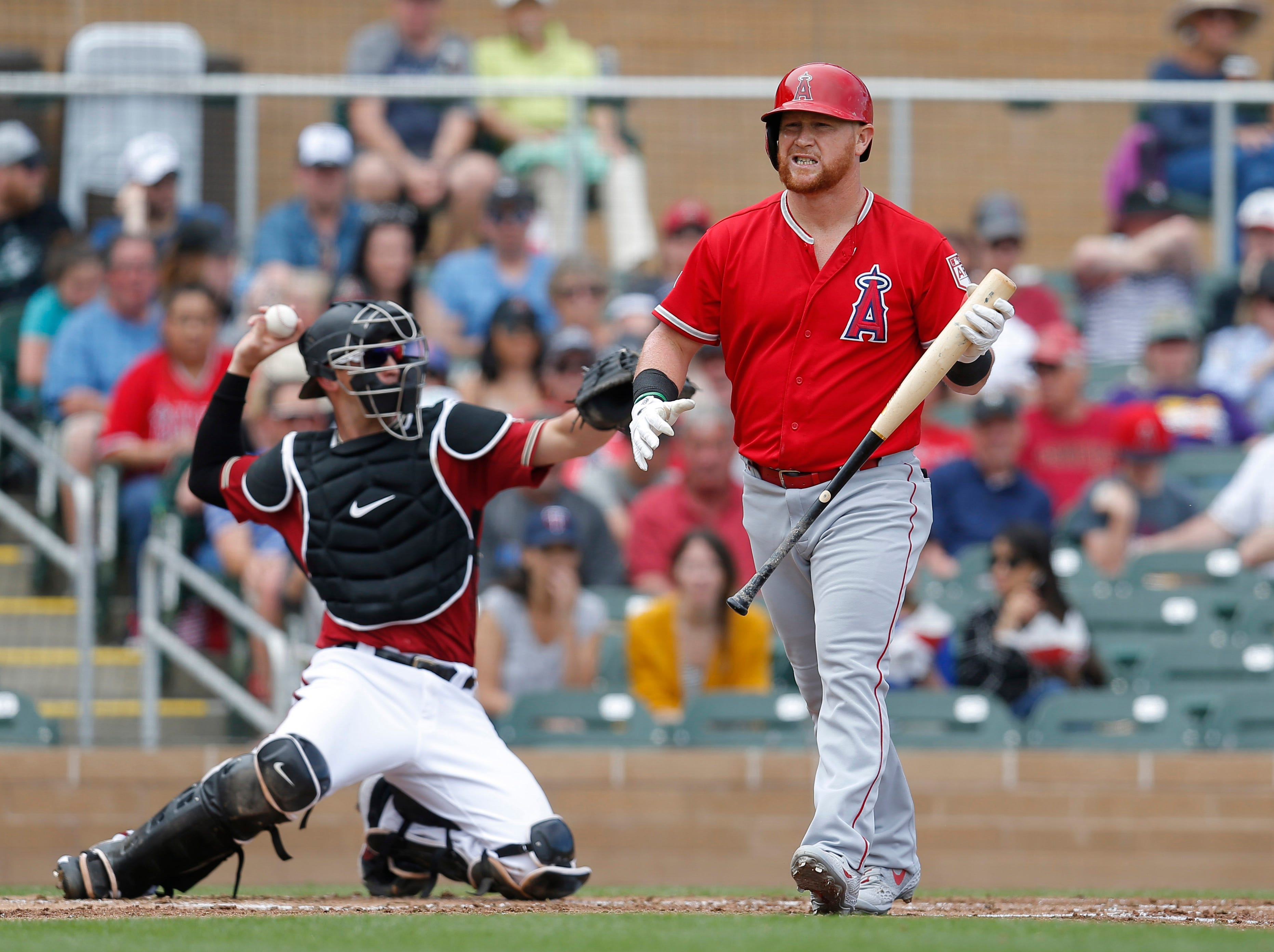 Angels right fielder Kole Calhoun (56) reacts after striking out against the Diamondbacks during the second inning of a spring training game at Salt River Fields.
