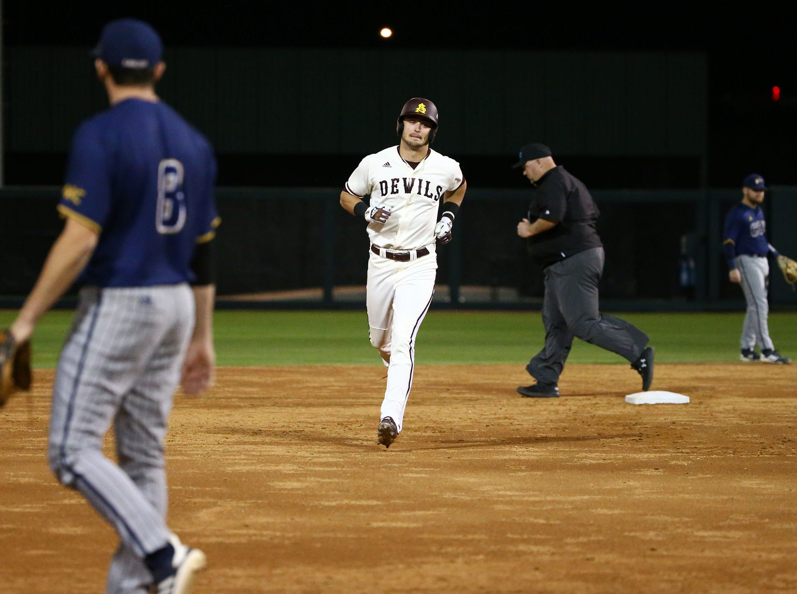Arizona State Sun Devils Hunter Bishop (4) hits a 2-run home run against the California Baptist Lancers in the third inning at Phoenix Municipal Stadium on Mar. 20, 2019 in Phoenix, Ariz.