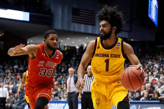Arizona State's Remy Martin (1) drives past St. John's LJ Figueroa (30) during the first half of a First Four game of the NCAA college basketball tournament, Wednesday, March 20, 2019, in Dayton, Ohio. (AP Photo/John Minchillo)