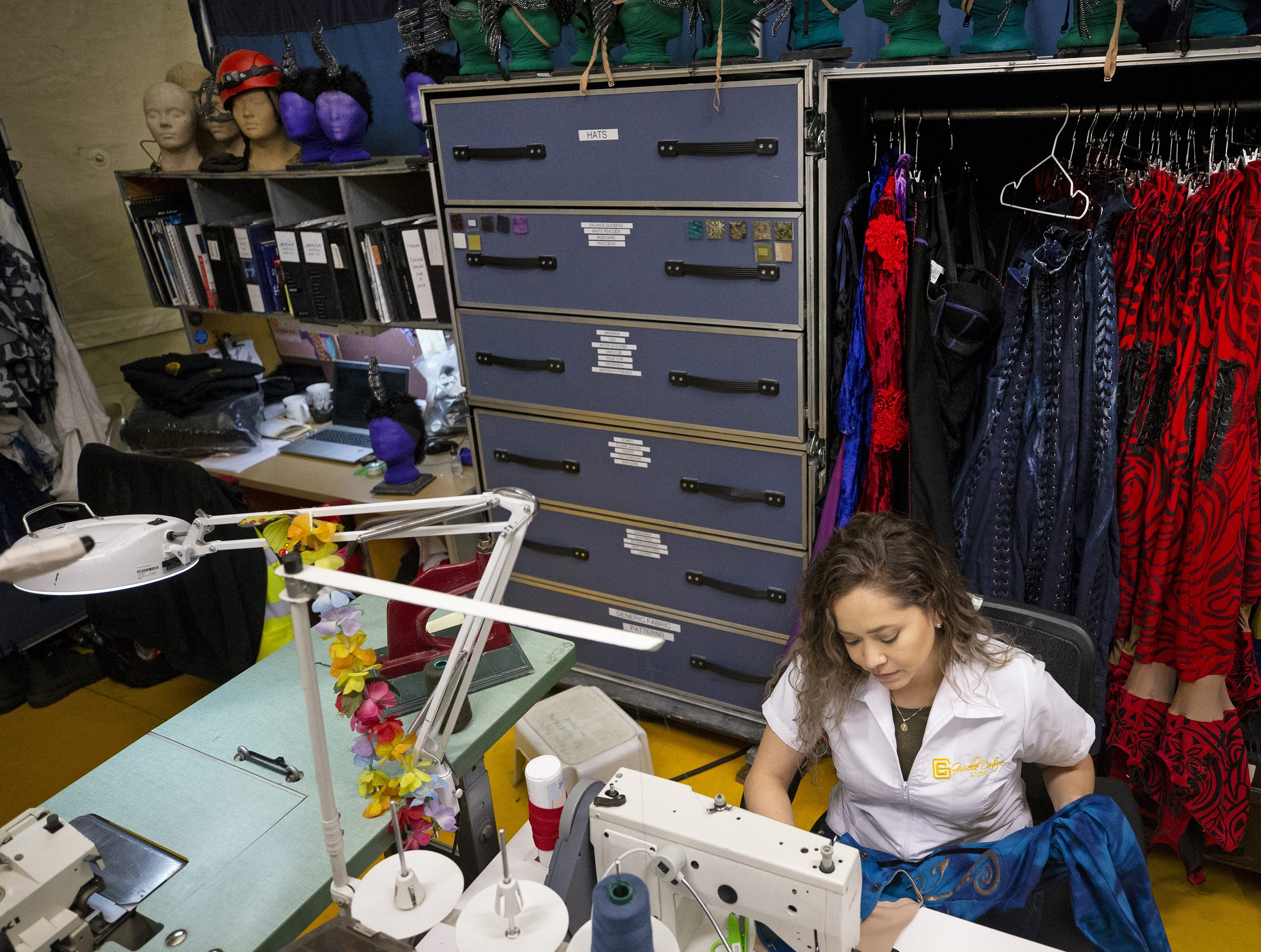 Gisselle Rojas, wardrobe technician, sews a costumes for Cirque du Soleil's big-top show, Amaluna, at State Farm Stadium in Glendale.