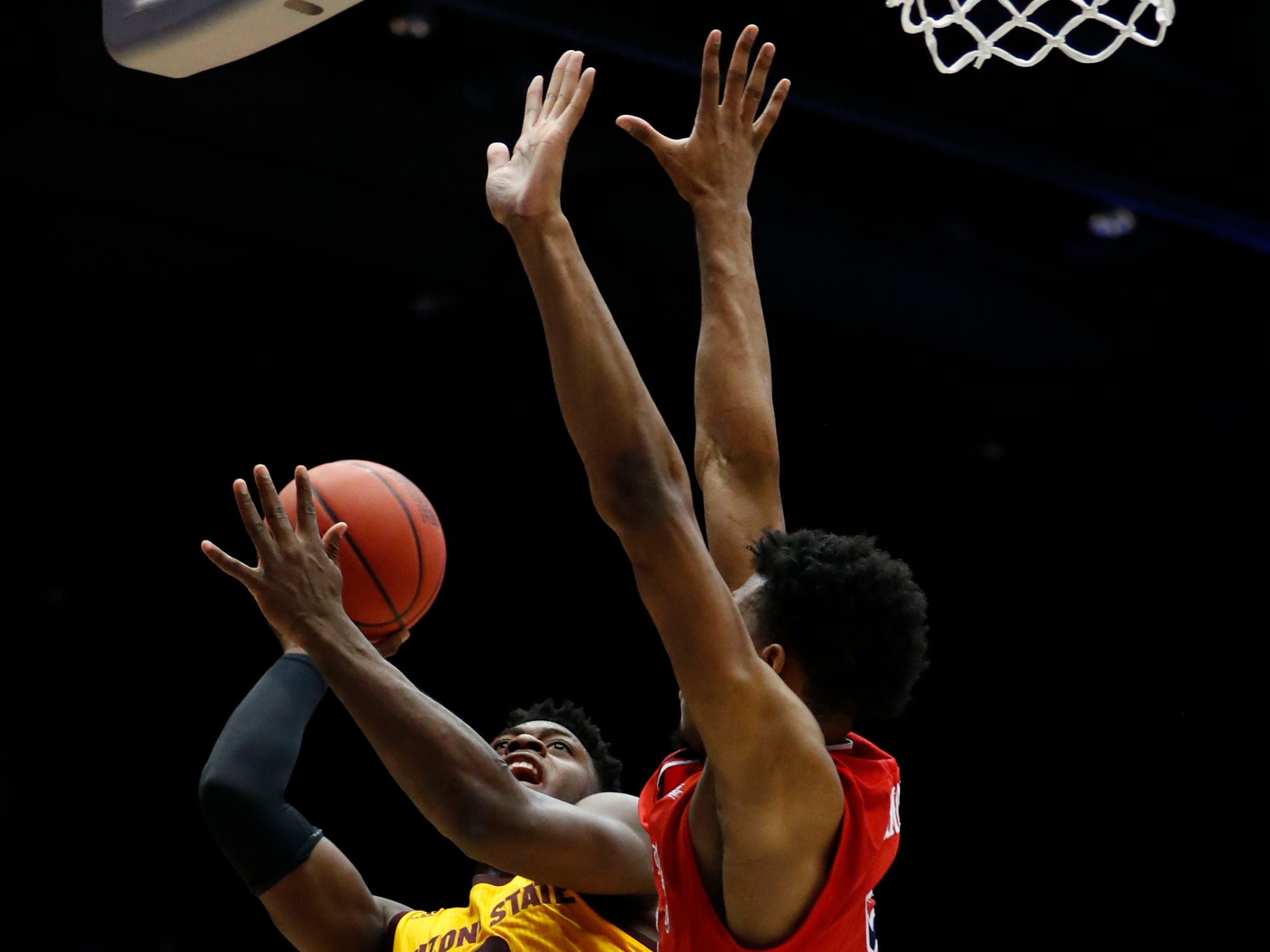 Mar 20, 2019; Dayton, OH, USA; Arizona State Sun Devils guard Luguentz Dort (0) goes to the basket defend by St. John's Red Storm guard Justin Simon (5) in the First Four of the 2019 NCAA Tournament at Dayton Arena. Mandatory Credit: Rick Osentoski-USA TODAY Sports