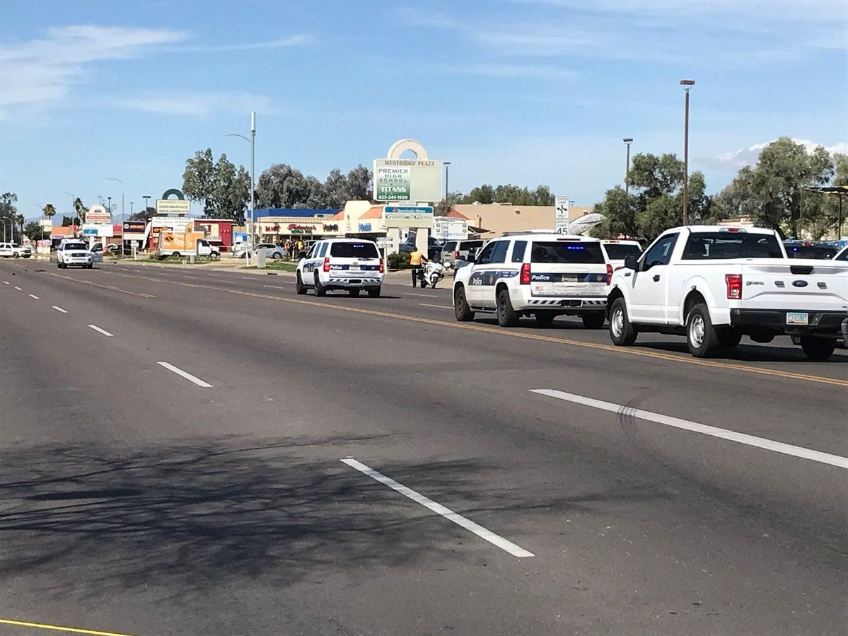 Phoenix police officer Paul Rutherford, 51, died Thursday after being struck by a vehicle while officers were investigating a collision at 75th Avenue and Indian School Road.