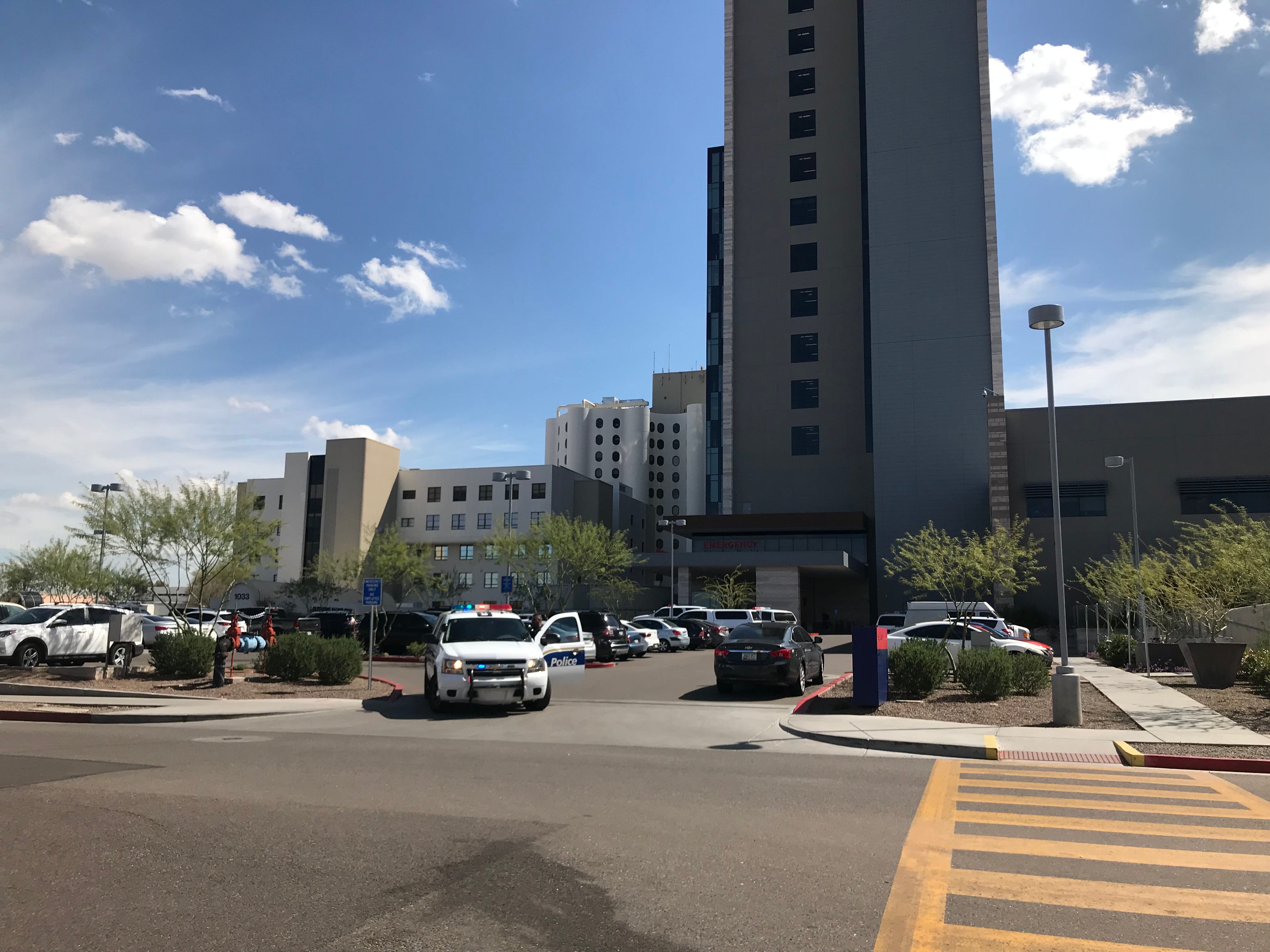 Phoenix police officers gather at Banner University Medical Center after Officer Paul Rutherford, 51, died on March 21, 2019, after being struck by a vehicle while officers were investigating a collision at 75th Avenue and Indian School Road.
