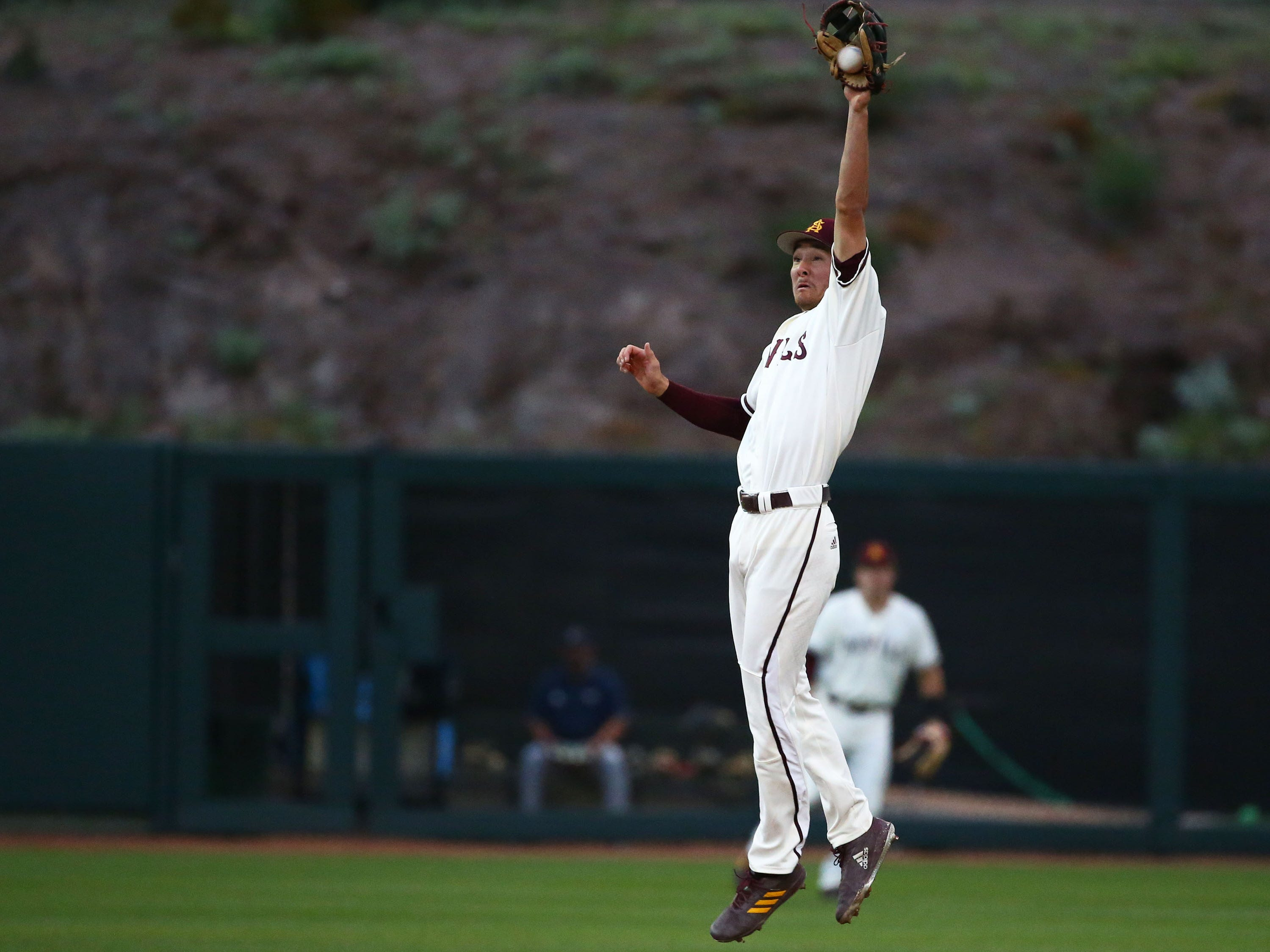 Arizona State Sun Devils shortstop Alika Williams makes a leaping catch on a line drive hit by California Baptist Lancers Chad Castillo in the first inning at Phoenix Municipal Stadium on Mar. 20, 2019 in Phoenix, Ariz.