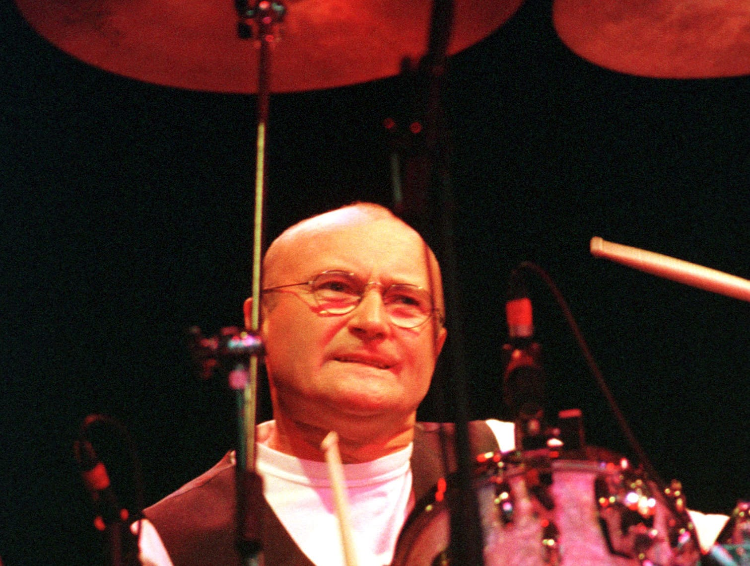 Phil Collins drums during his concert with his band Genesis in Cologne July 9, 1998. He played the old Genesis songs without singing, only playing the drums.