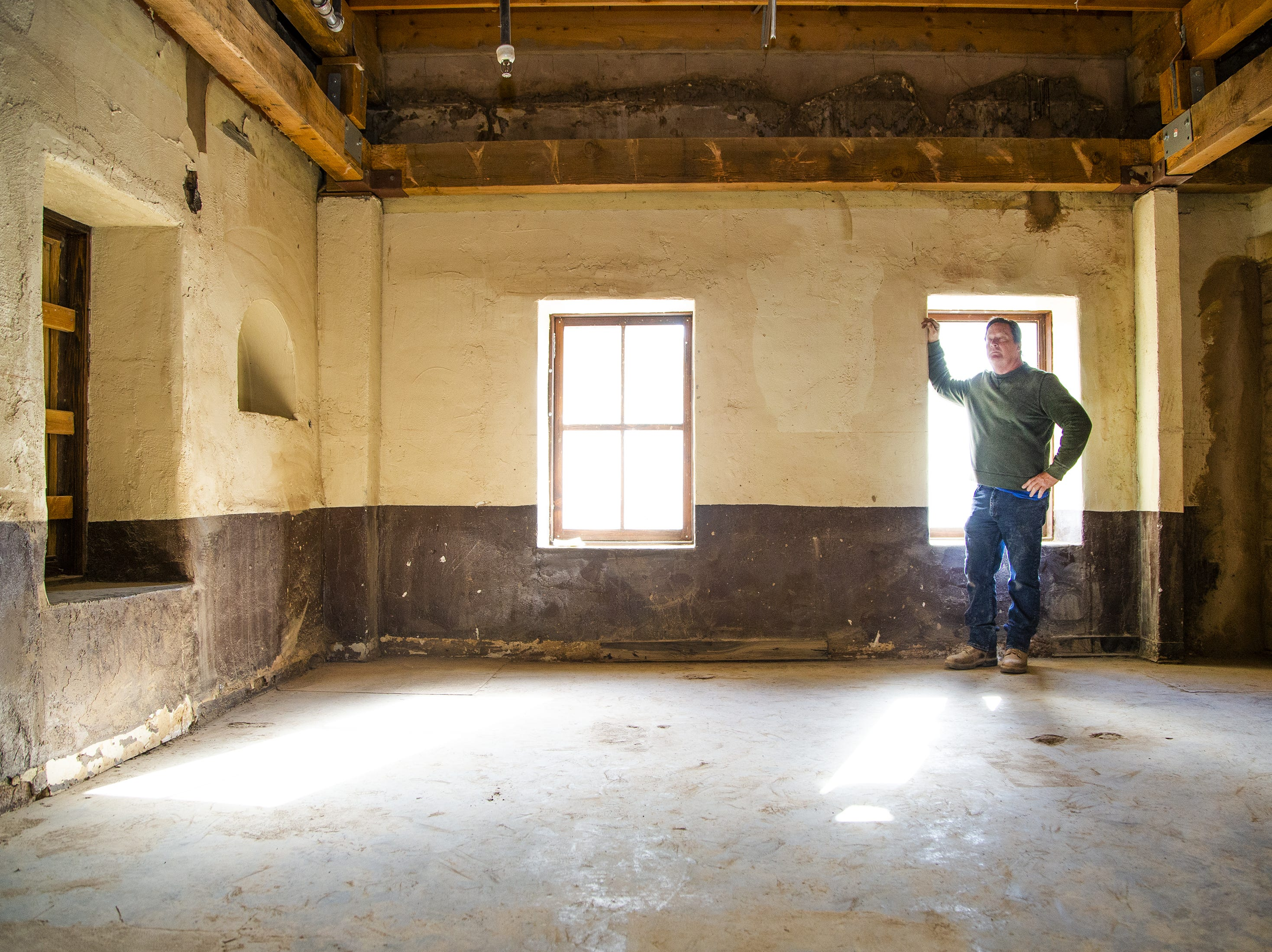 Reggie Mackay of Adobe Technology shows off the interior of the room that Carl Hayden was born in at Monti's La Casa Vieja.  Parts of the historic building, on Mill Avenue in Tempe, are being torn down on March 21, 2019. The parts of the building that are original, dating back to the late 1800s, are being retained. Only add-ons and additions made in later years are being torn down.