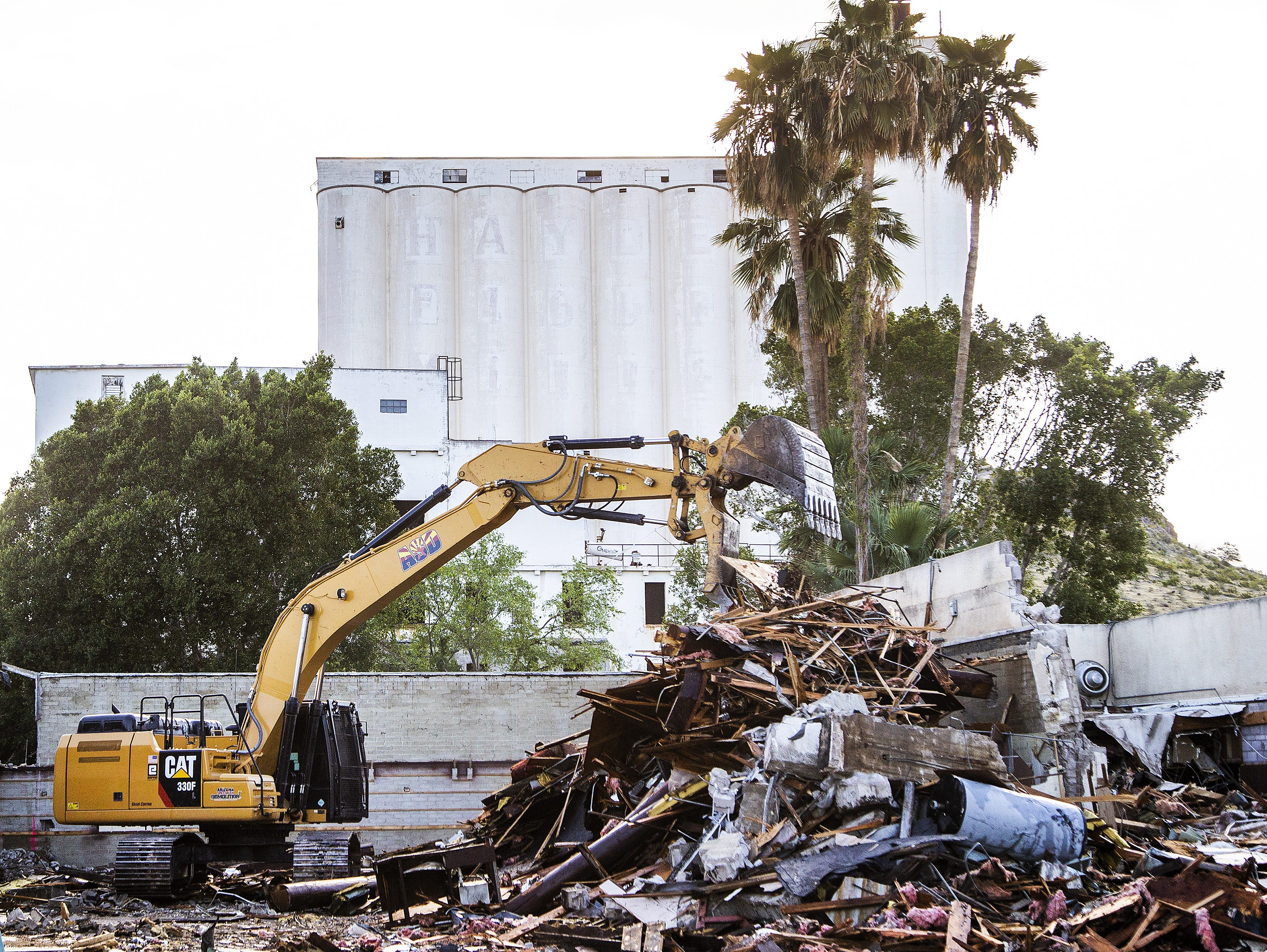 Workers tear down part of the old Monti's La Casa Vieja on Mill Avenue in Tempe on March 21, 2019.   The parts of the building that are original, dating back to the late 1800s, are being retained. Only add-ons and additions made in later years are being torn down.