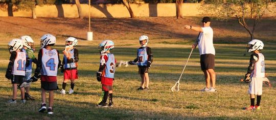 Scottsdale United coach Casey Connor instructs his 8u team during a scrimmage at practice in Cactus Park, Tuesday, March 19, 2019, in Scottsdale, Arizona.