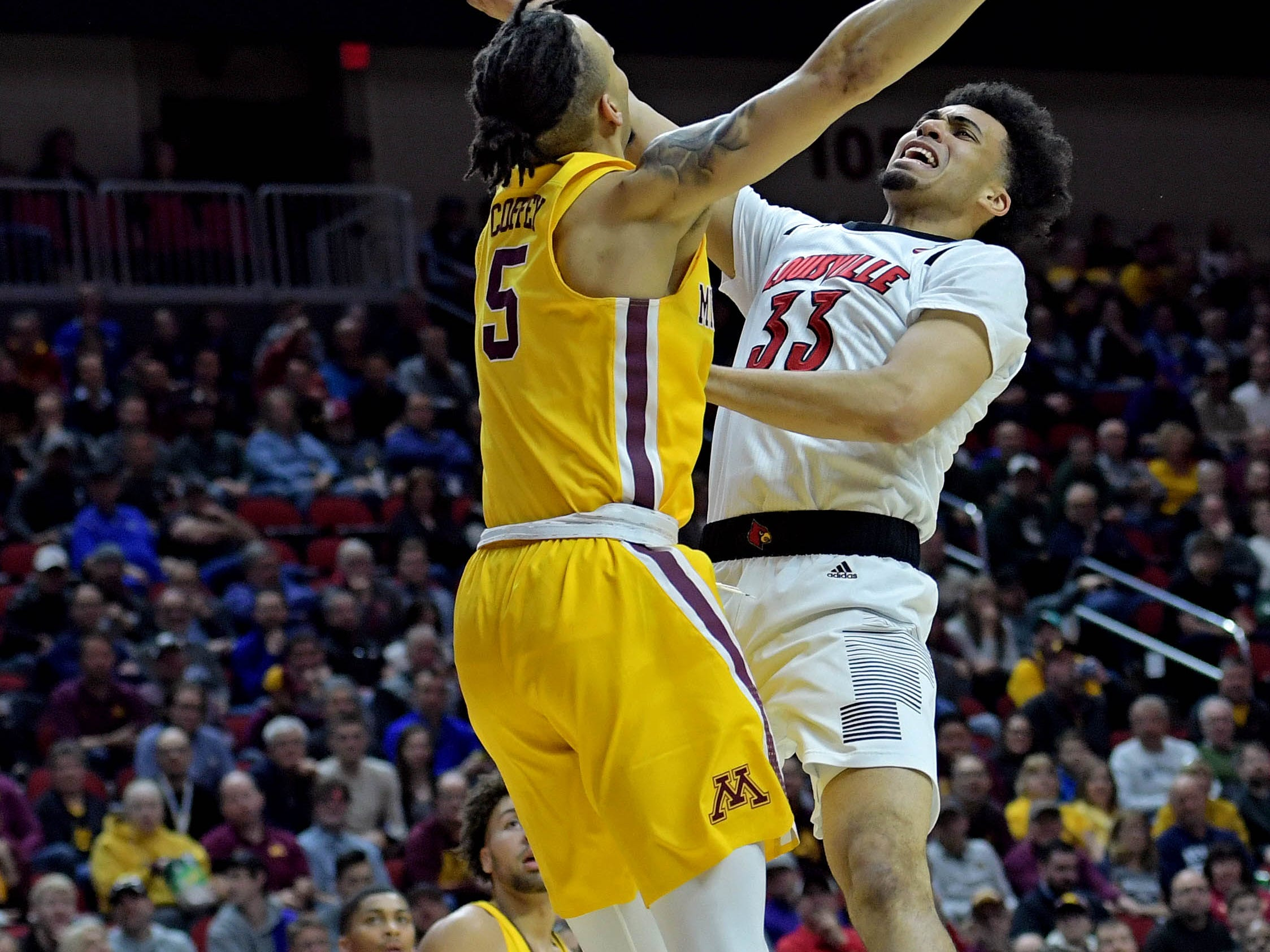 Mar 21, 2019; Des Moines, IA, United States; Louisville Cardinals forward Jordan Nwora (33) shoots the ball against Minnesota Golden Gophers guard Amir Coffey (5) during the first half in the first round of the 2019 NCAA Tournament at Wells Fargo Arena. Mandatory Credit: Steven Branscombe-USA TODAY Sports