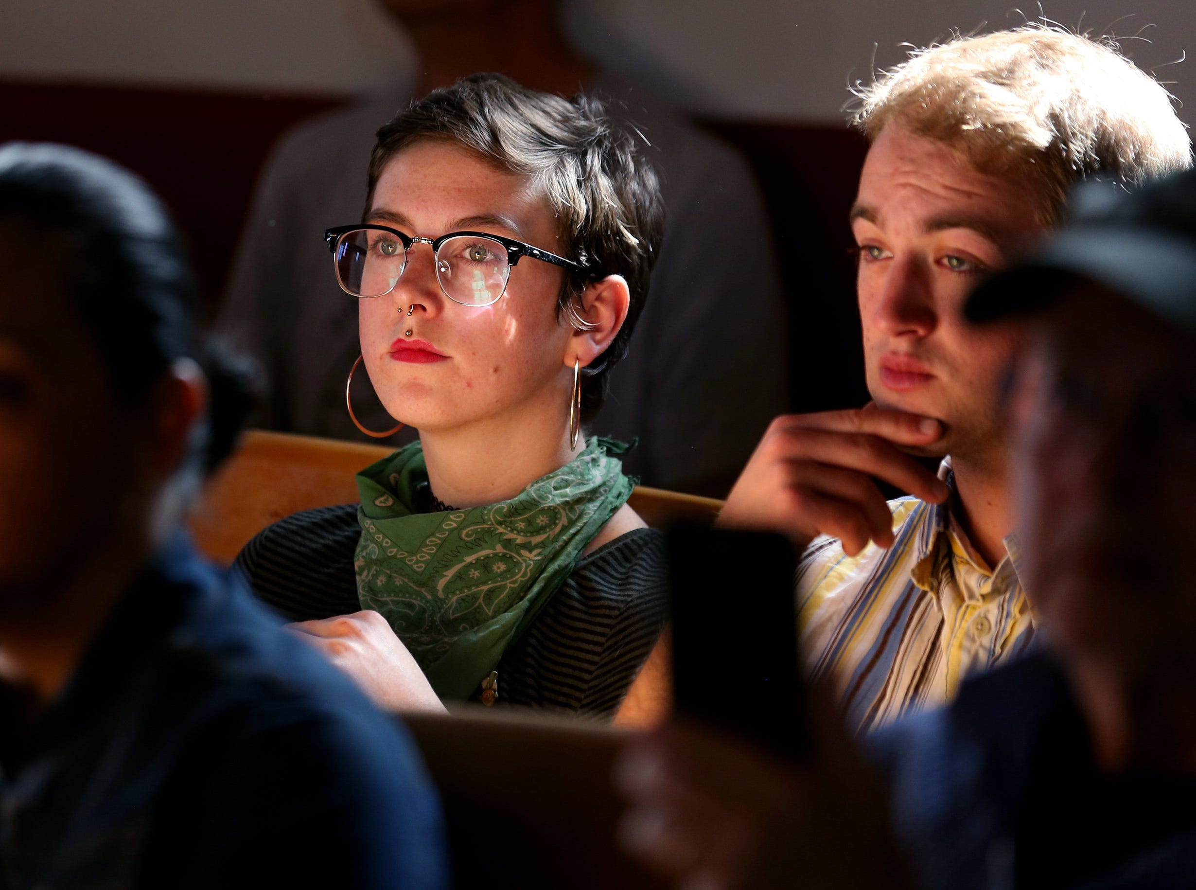 A woman in the crowd looks on during a press conference on March 20, 2019, at Southside Presbyterian Church, 317 W. 23rd St., in Tucson. A family of three was arrested after a traffic stop by a state trooper where Border Patrol was called to assist.