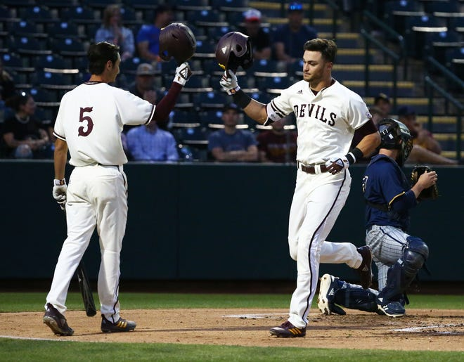 Arizona State Sun Devils Hunter Bishop (right) hits a solo home run against the California Baptist Lancers in the first inning at Phoenix Municipal Stadium on Mar. 20, 2019 in Phoenix, Ariz.