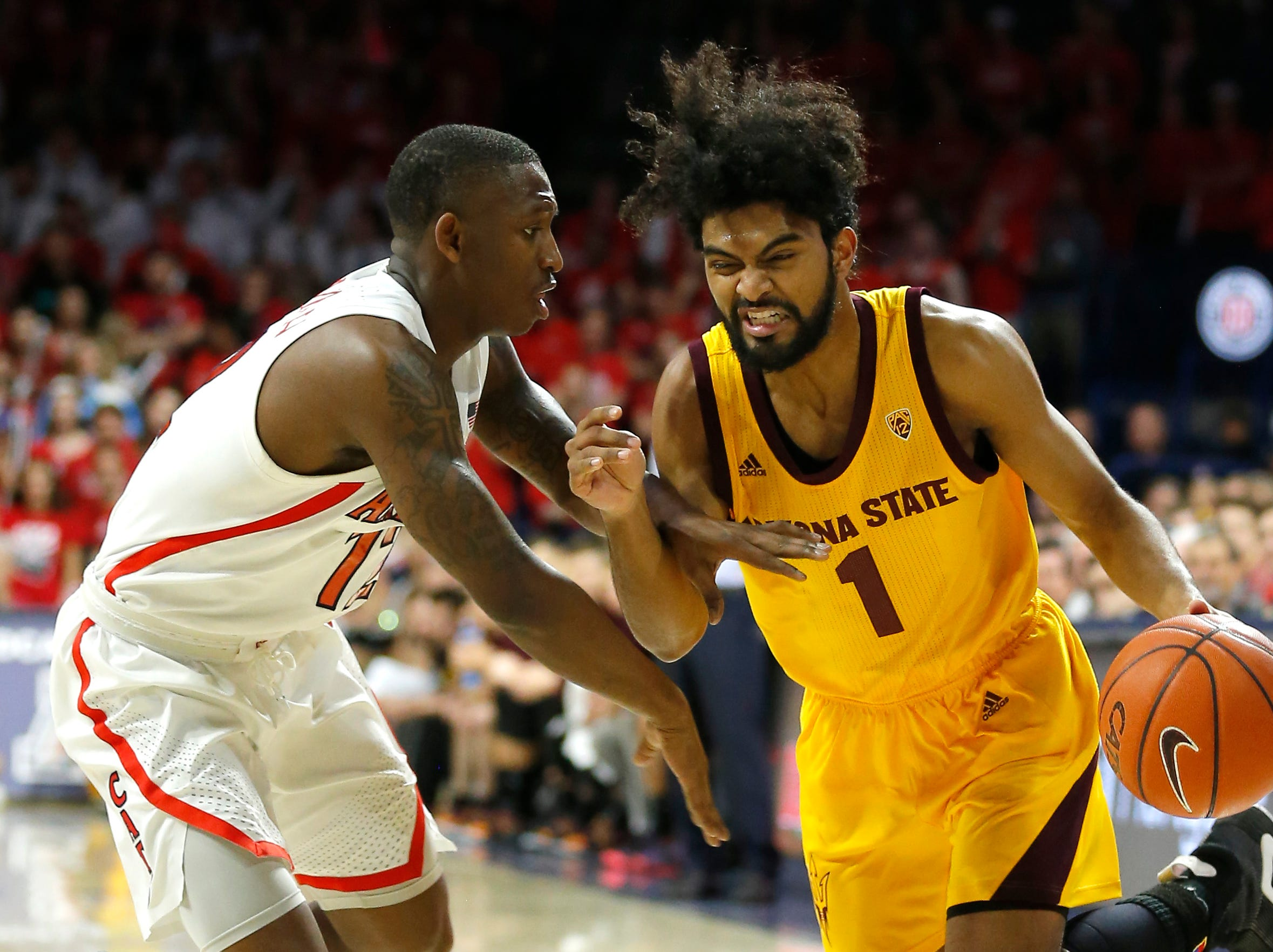 Arizona State guard Remy Martin, right, drives on Arizona guard Justin Coleman, left, in the first half during an NCAA college basketball game, Saturday, March 9, 2019, in Tucson, Ariz. (AP Photo/Rick Scuteri)