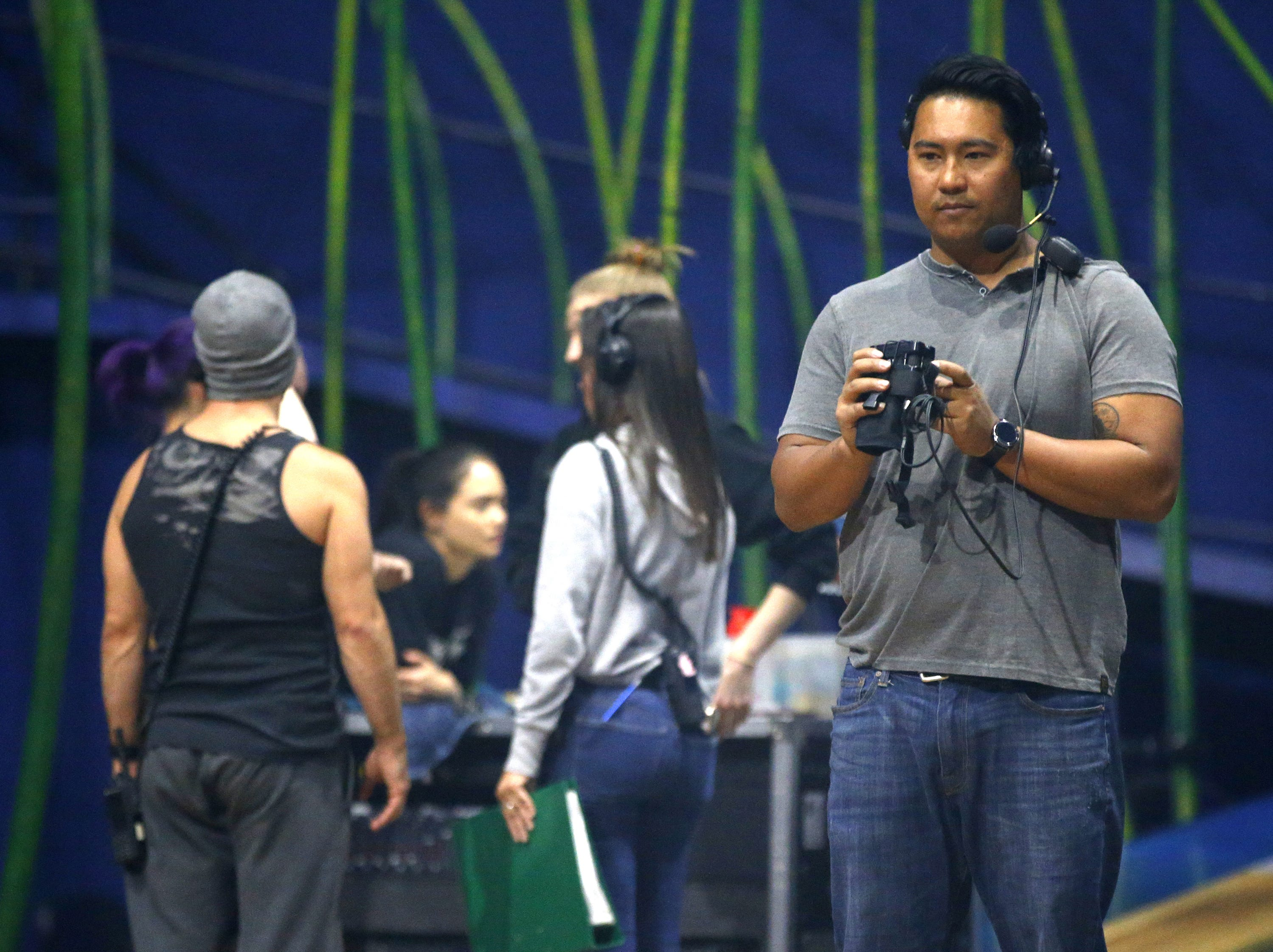 Emille Morales, head of rigging for Cirque du Soleil's big-top show Amaluna, checks equipment at State Farm Stadium in Glendale.