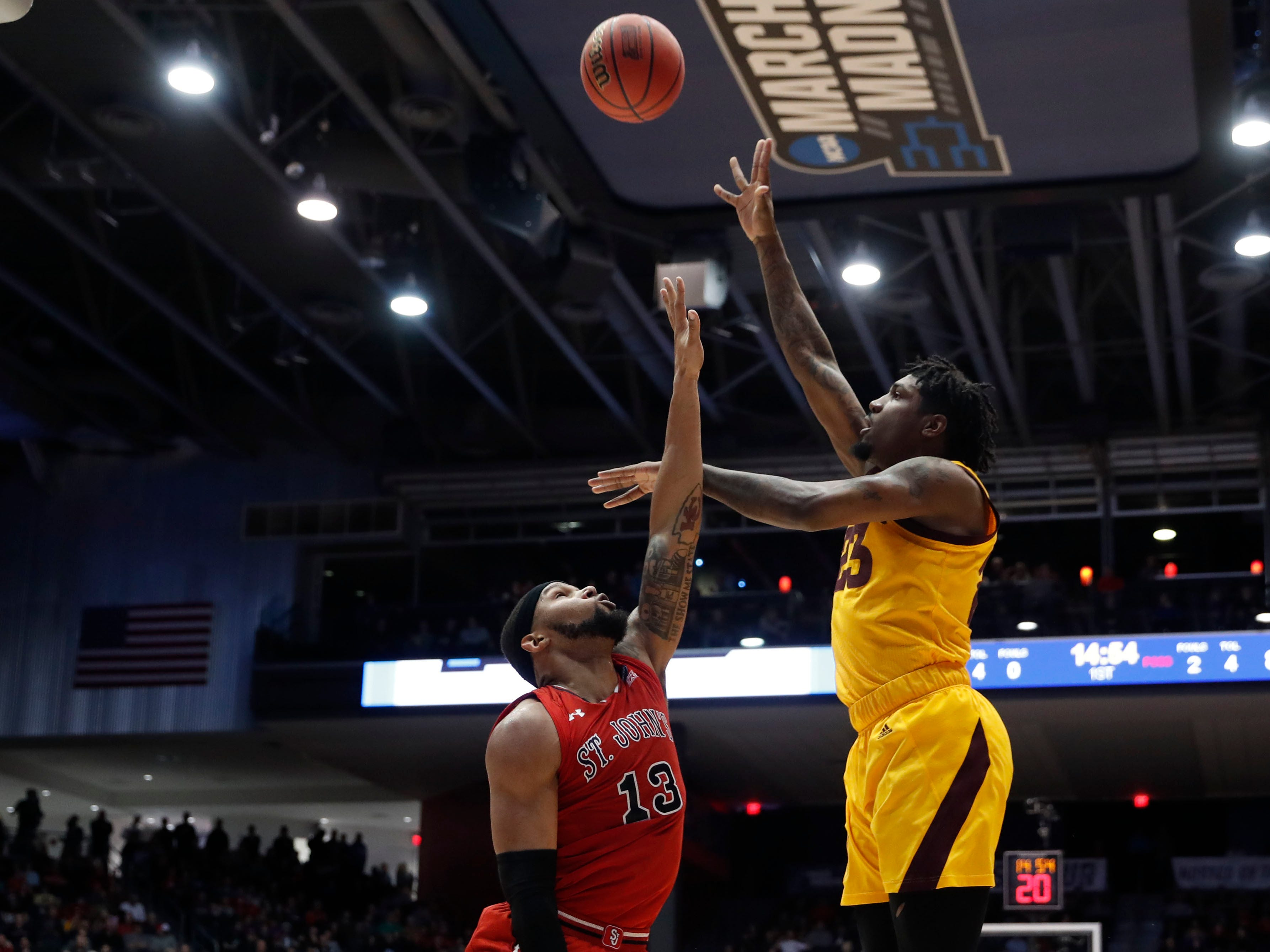 Mar 20, 2019; Dayton, OH, USA; Arizona State Sun Devils forward Romello White (23) shoots the ball over St. John's Red Storm forward Marvin Clark II (13) in the first half in the First Four of the 2019 NCAA Tournament at Dayton Arena. Mandatory Credit: Brian Spurlock -USA TODAY Sports