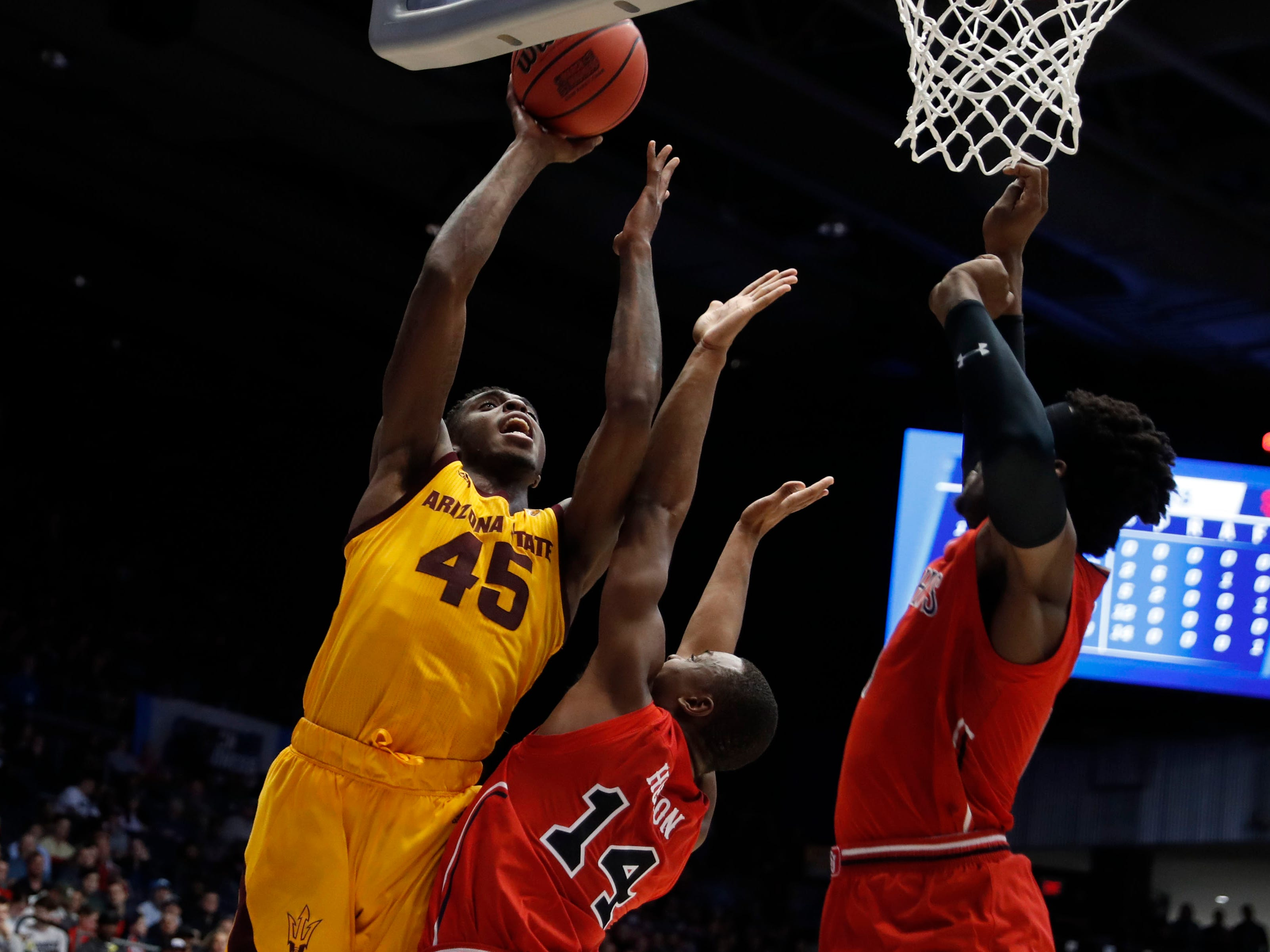 Mar 20, 2019; Dayton, OH, USA; Arizona State Sun Devils forward Zylan Cheatham (45) goes to the basket defended by St. John's Red Storm guard Mustapha Heron (14) in the first half in the First Four of the 2019 NCAA Tournament at Dayton Arena. Mandatory Credit: Brian Spurlock -USA TODAY Sports