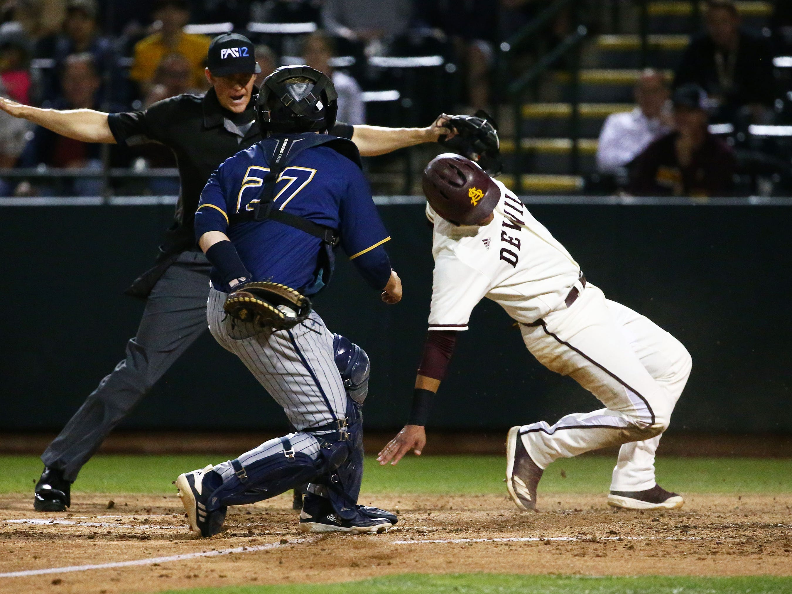 Arizona State Sun Devils Carter Aldrete (21) scores past the late tag by California Baptist Lancers catcher Rory Smith in the third inning at Phoenix Municipal Stadium on Mar. 20, 2019 in Phoenix, Ariz.